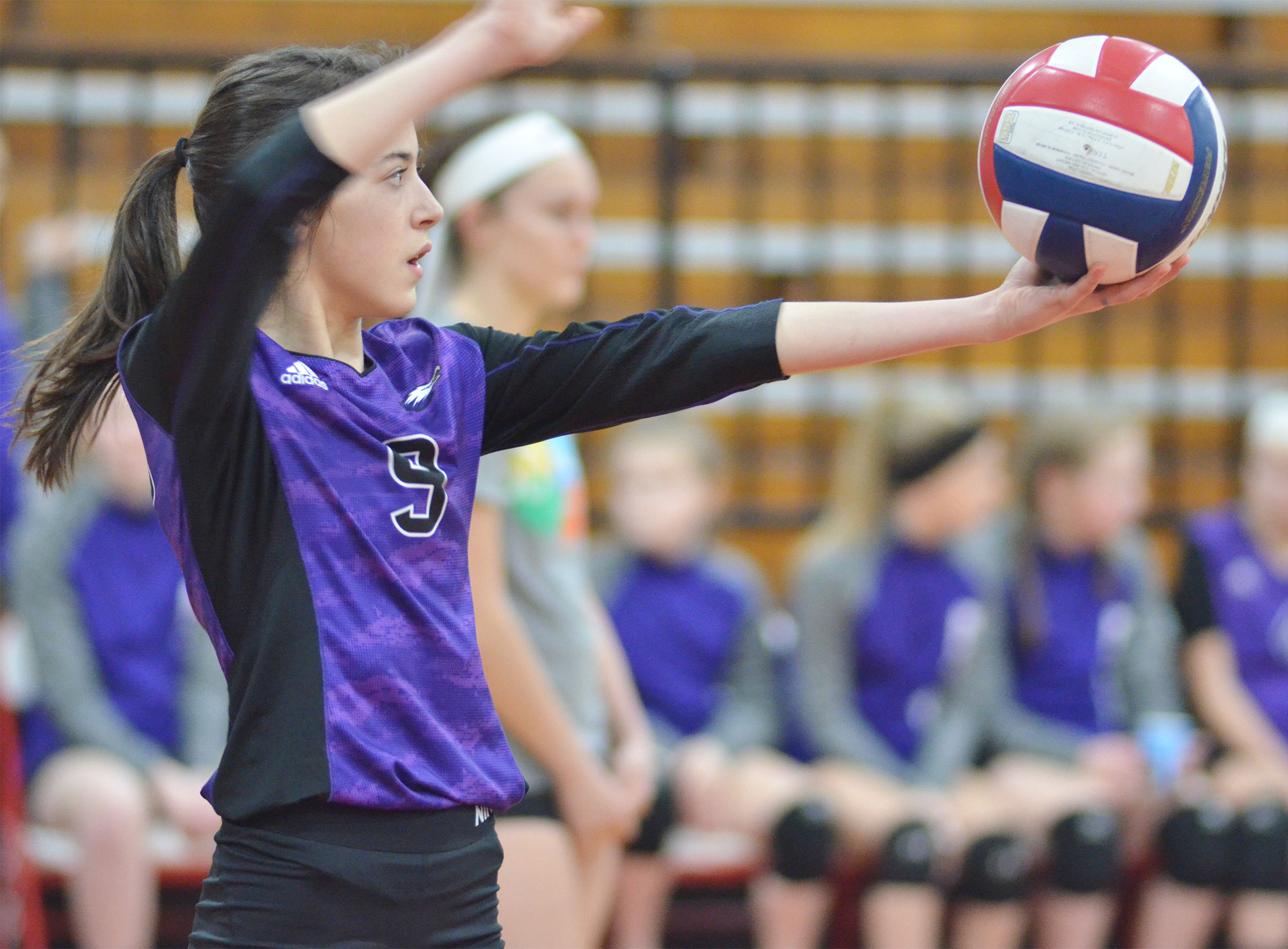 CMS seventh-grader Kaylyn Smith serves.