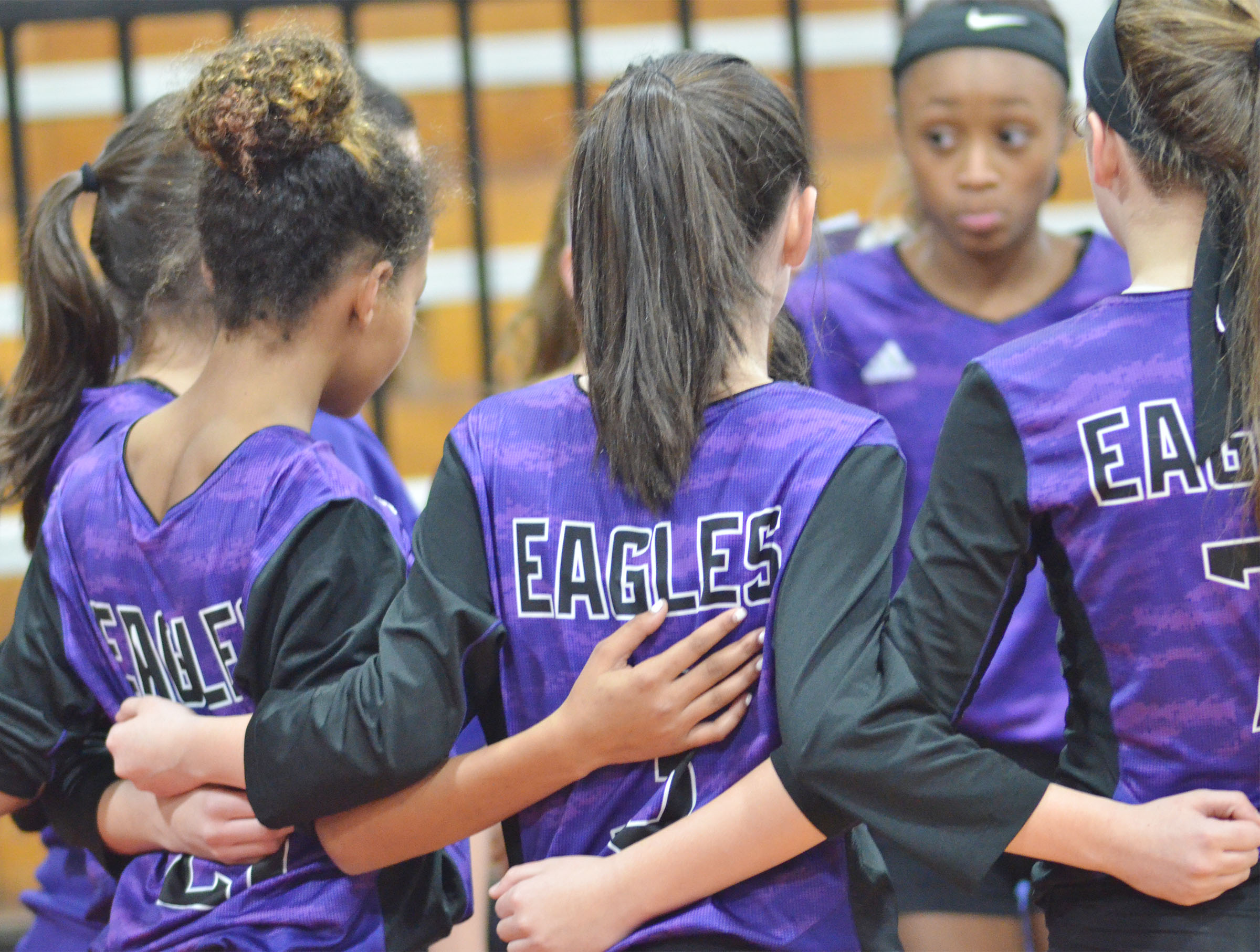CMS volleyball players talk during a time out.