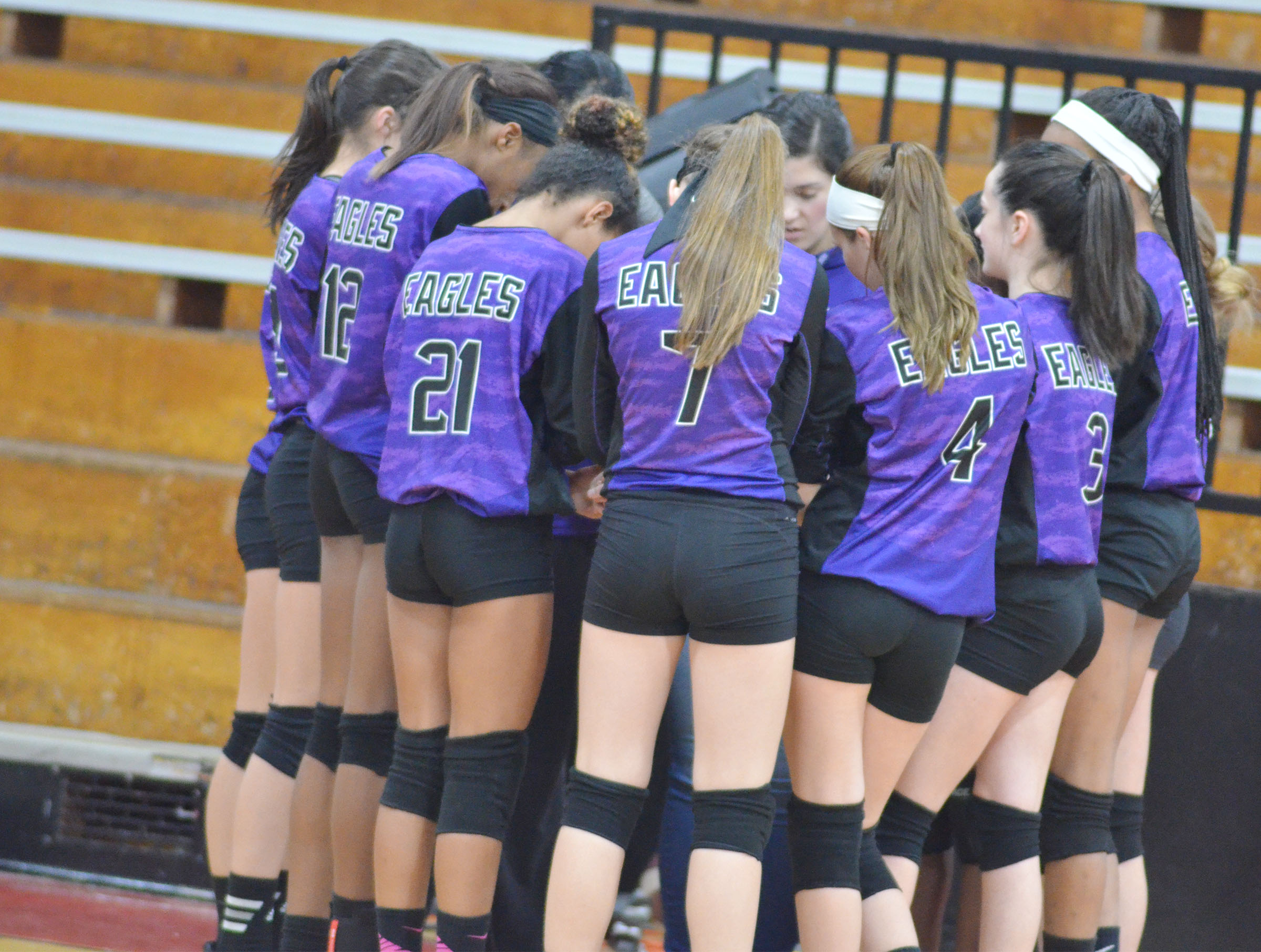 CMS volleyball players huddle before the game.