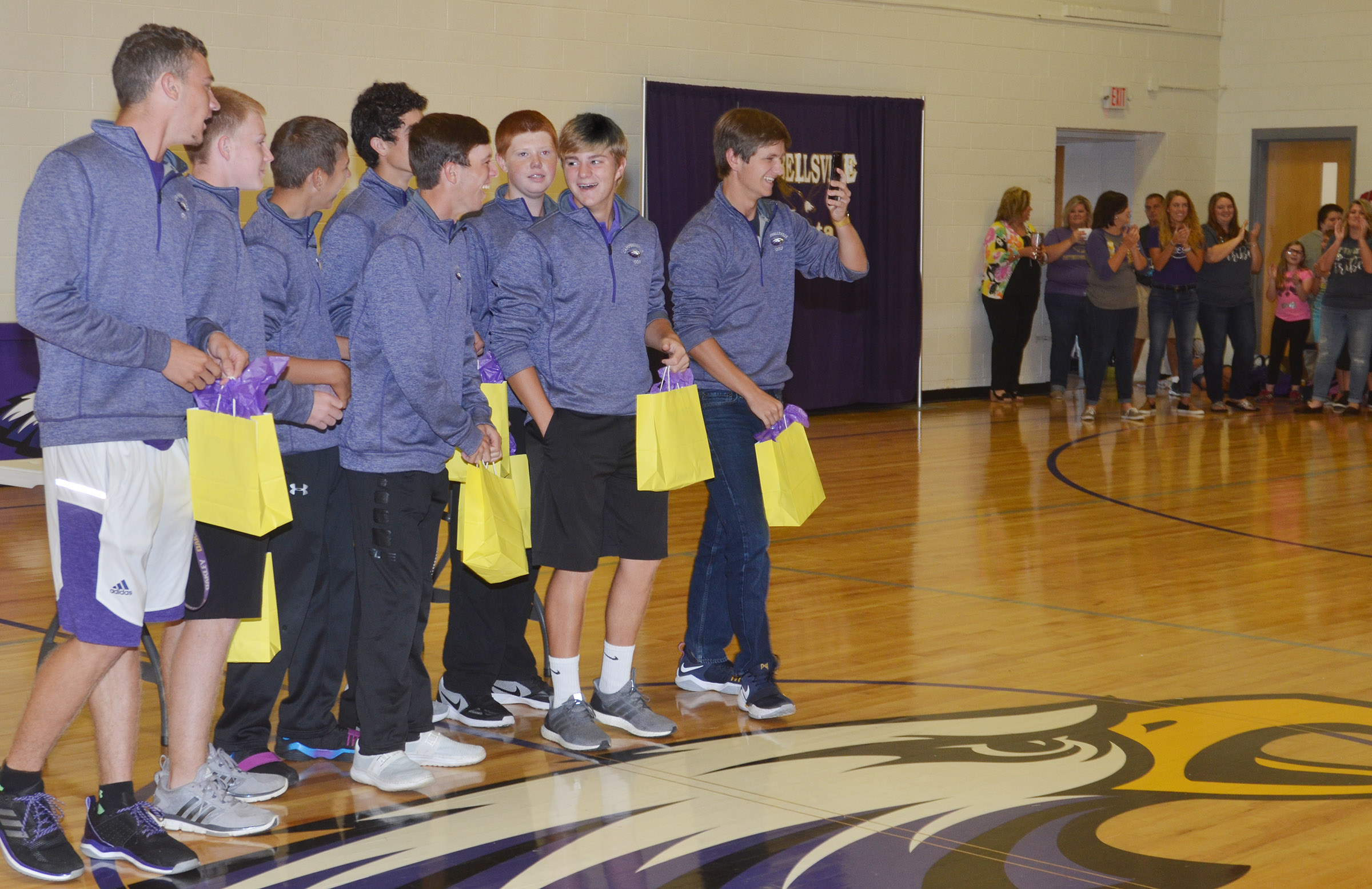 CHS golf players are honored at a CES assembly.