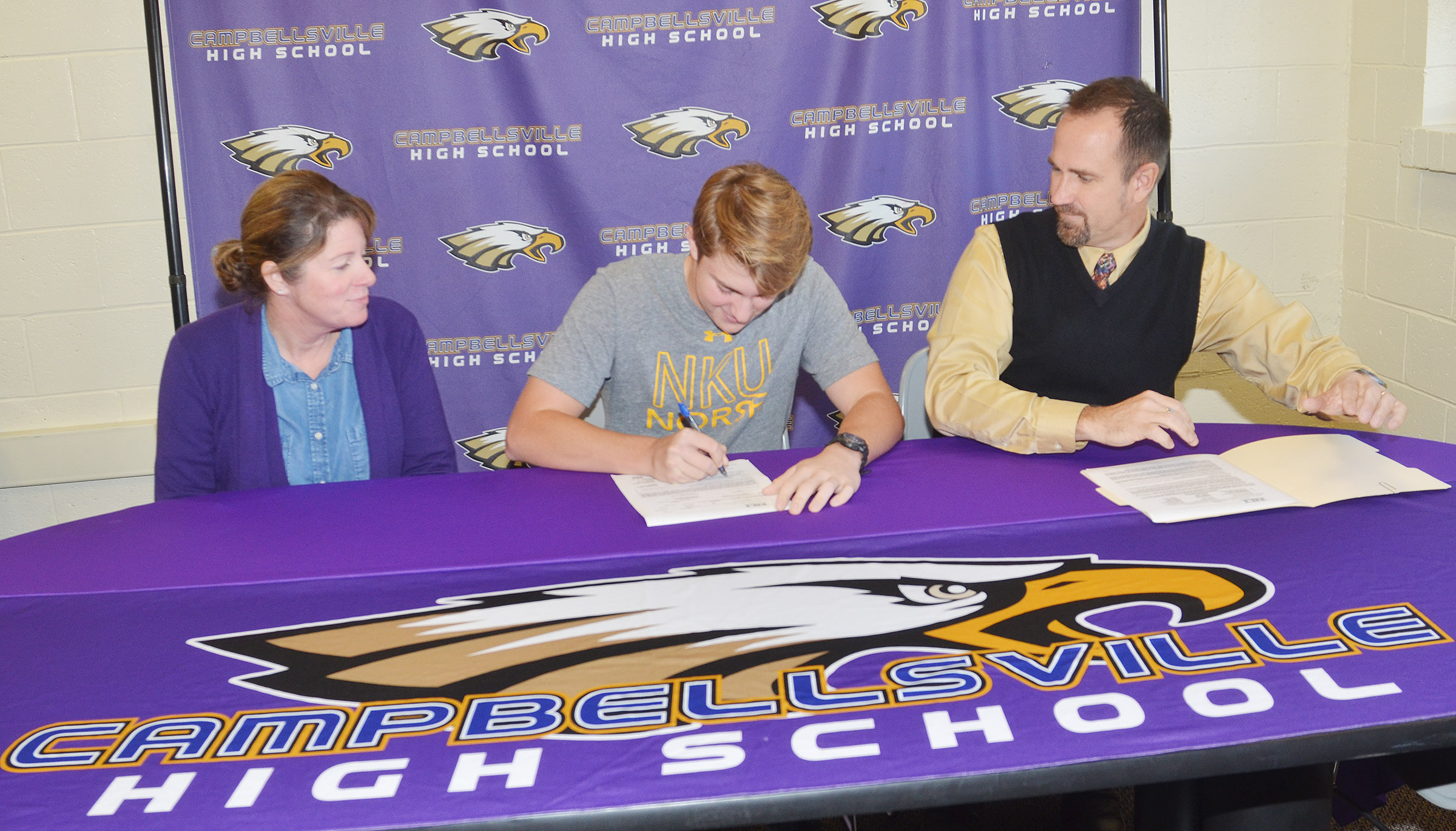 CHS boys' golf player Alex Doss will continue his academic and athletic career at Northern Kentucky University. He recently signed his scholarship paperwork with his parents, Steve and Dee Doss. Mrs. Doss is the college and career readiness counselor at CHS, and Mr. Doss is an exceptional child educator at CHS.