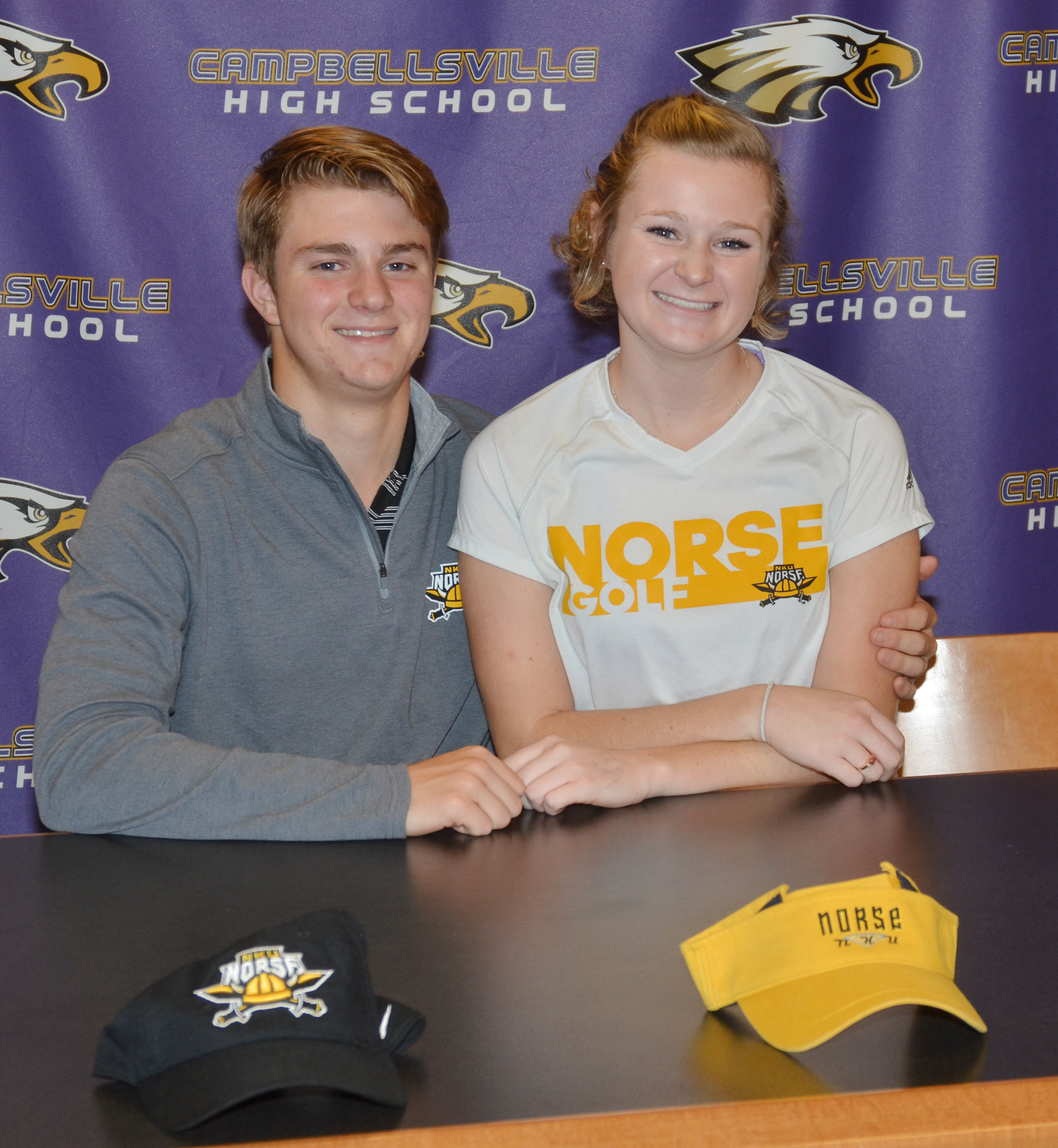 CHS boys' golf player Alex Doss will continue his academic and athletic career at Northern Kentucky University. He recently celebrated the announcement in a reception with his family and friends. Pictured with Doss are his sister, Kathryn, who also attends NKU and plays golf.