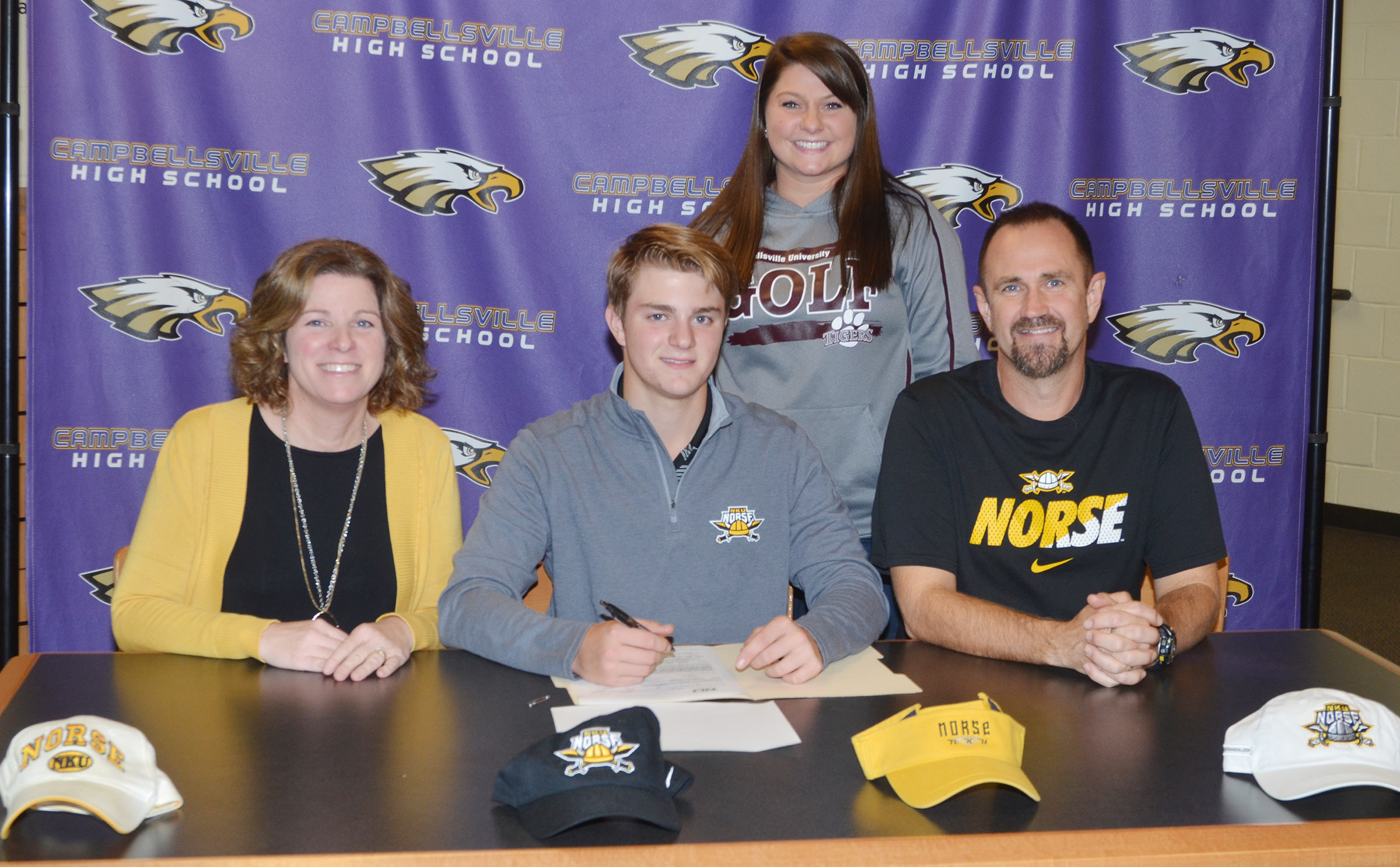 CHS boys' golf player Alex Doss will continue his academic and athletic career at Northern Kentucky University. He recently celebrated the announcement in a reception with his family and friends. Pictured with Doss are his parents, Steve and Dee, and CHS boys' golf coach Cassidy Decker.