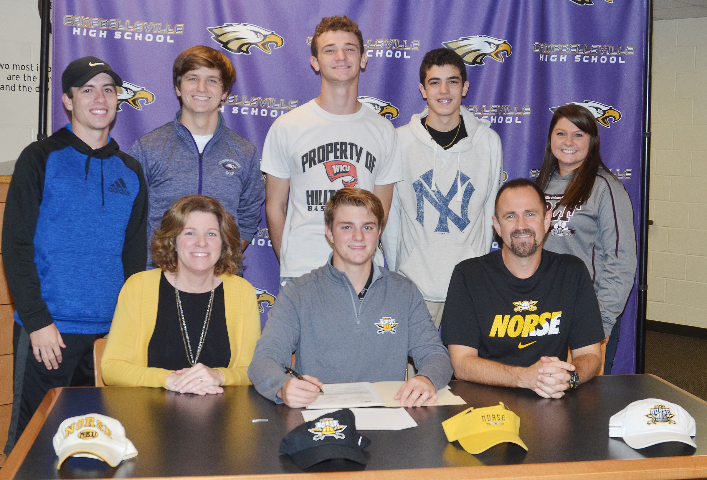 CHS boys' golf player Alex Doss will continue his academic and athletic career at Northern Kentucky University. He recently celebrated the announcement in a reception with his family and friends. Pictured with Doss are his parents, Steve and Dee, and, from left, back, teammates Layton Hord and Myles Murrell, juniors, senior Connor Wilson, freshman Kameron Smith and boys' golf coach Cassidy Decker.