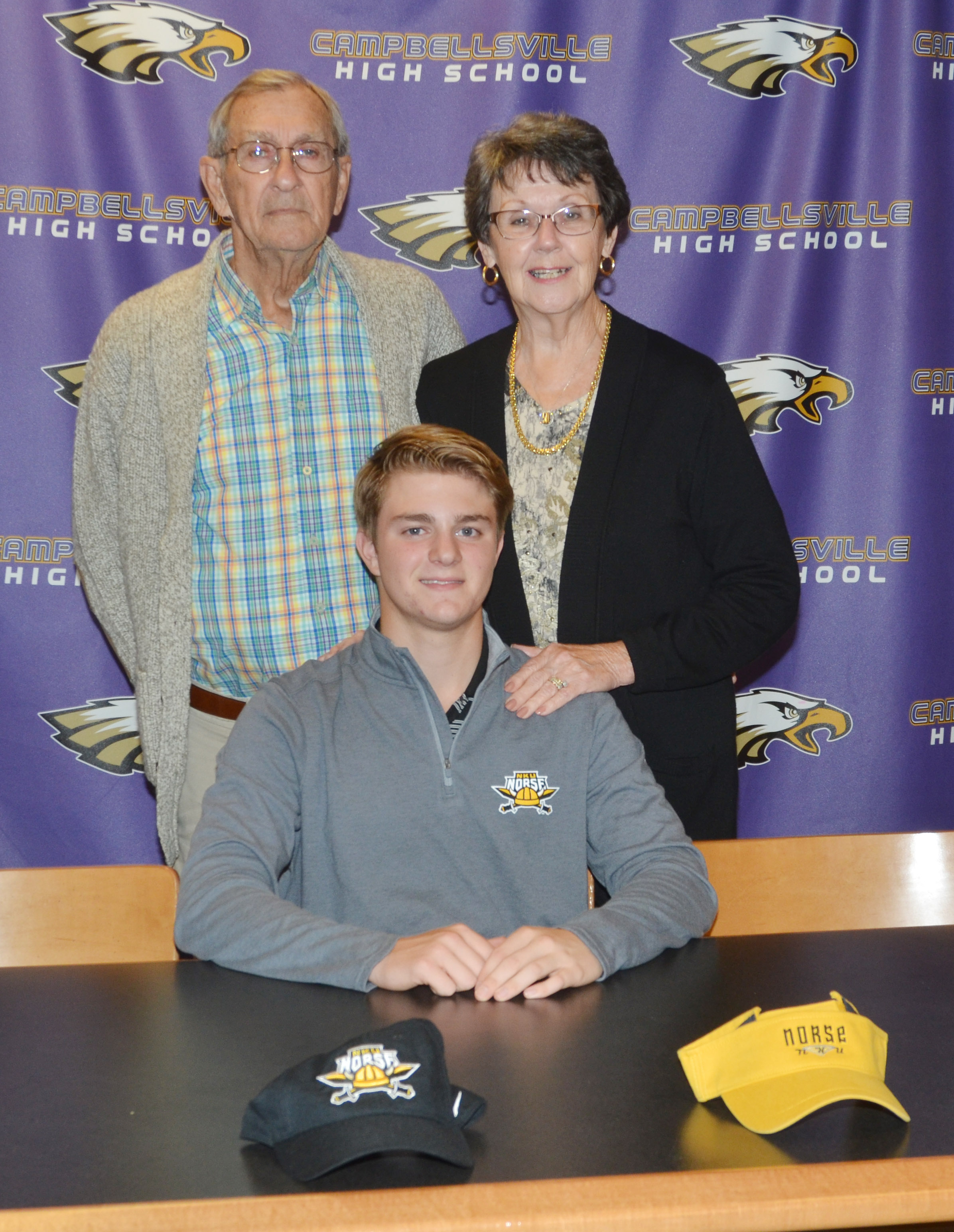 CHS boys' golf player Alex Doss will continue his academic and athletic career at Northern Kentucky University. He recently celebrated the announcement in a reception with his family and friends. Pictured with Doss with his grandparents.