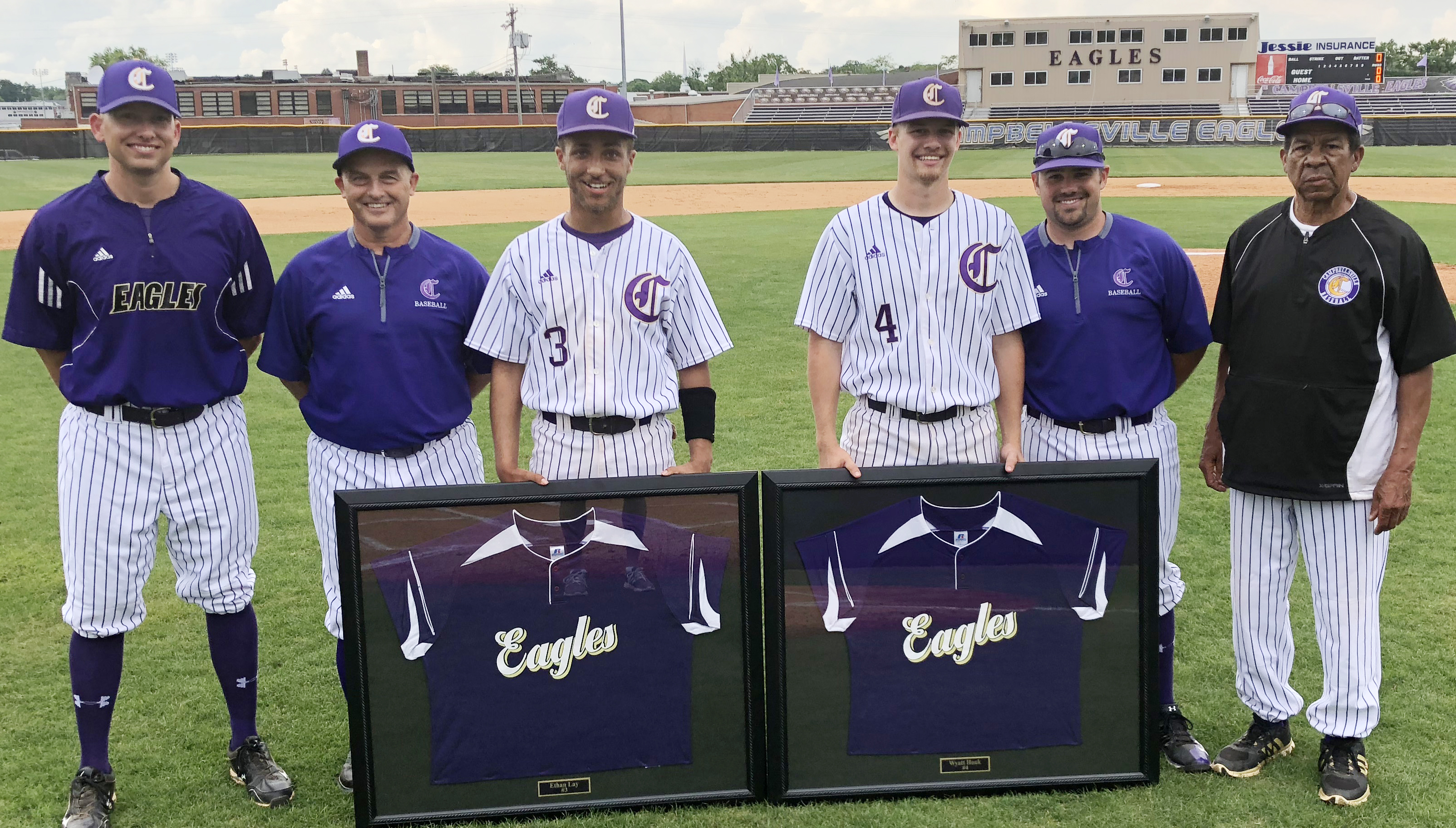 CHS seniors Ethan Lay and Wyatt Houk, third and fourth from left, are honored for their dedication to the Eagle baseball program. They are pictured with, from left, assistant coaches Zach Lewis and Lynn Kearney, head coach Blake Milby and assistant coach Phil Gowdy.