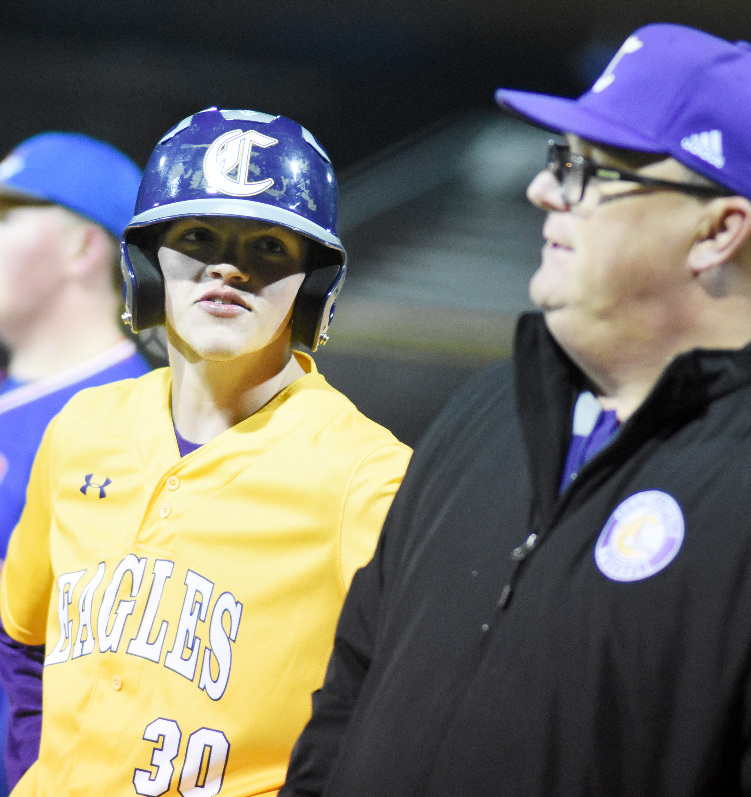 CHS sophomore Jimmy Russell talks to assistant coach Sarge Pollock after his at bat.