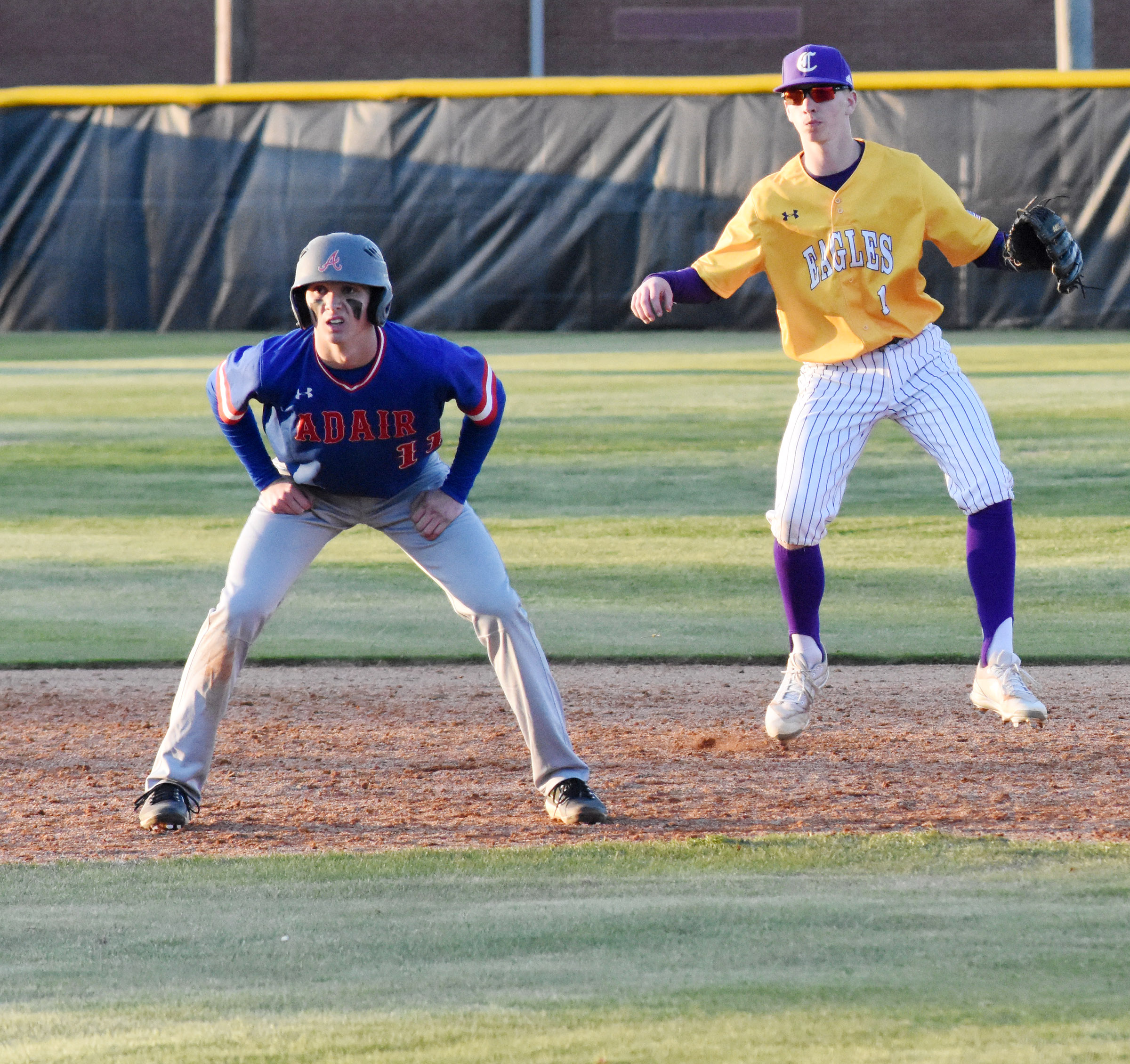 CHS freshman Arren Hash keeps the runner close at second.