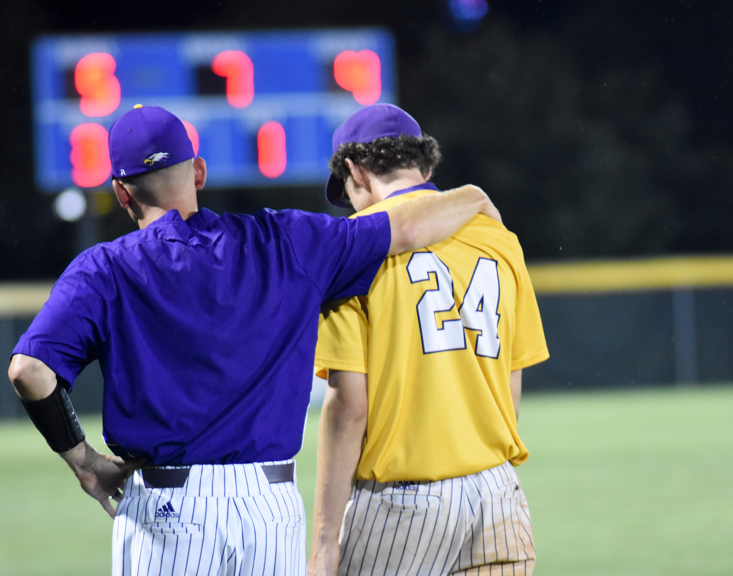 CHS baseball assistant coach Zach Lewis talks with sophomore Brennon Wheeler after the game.