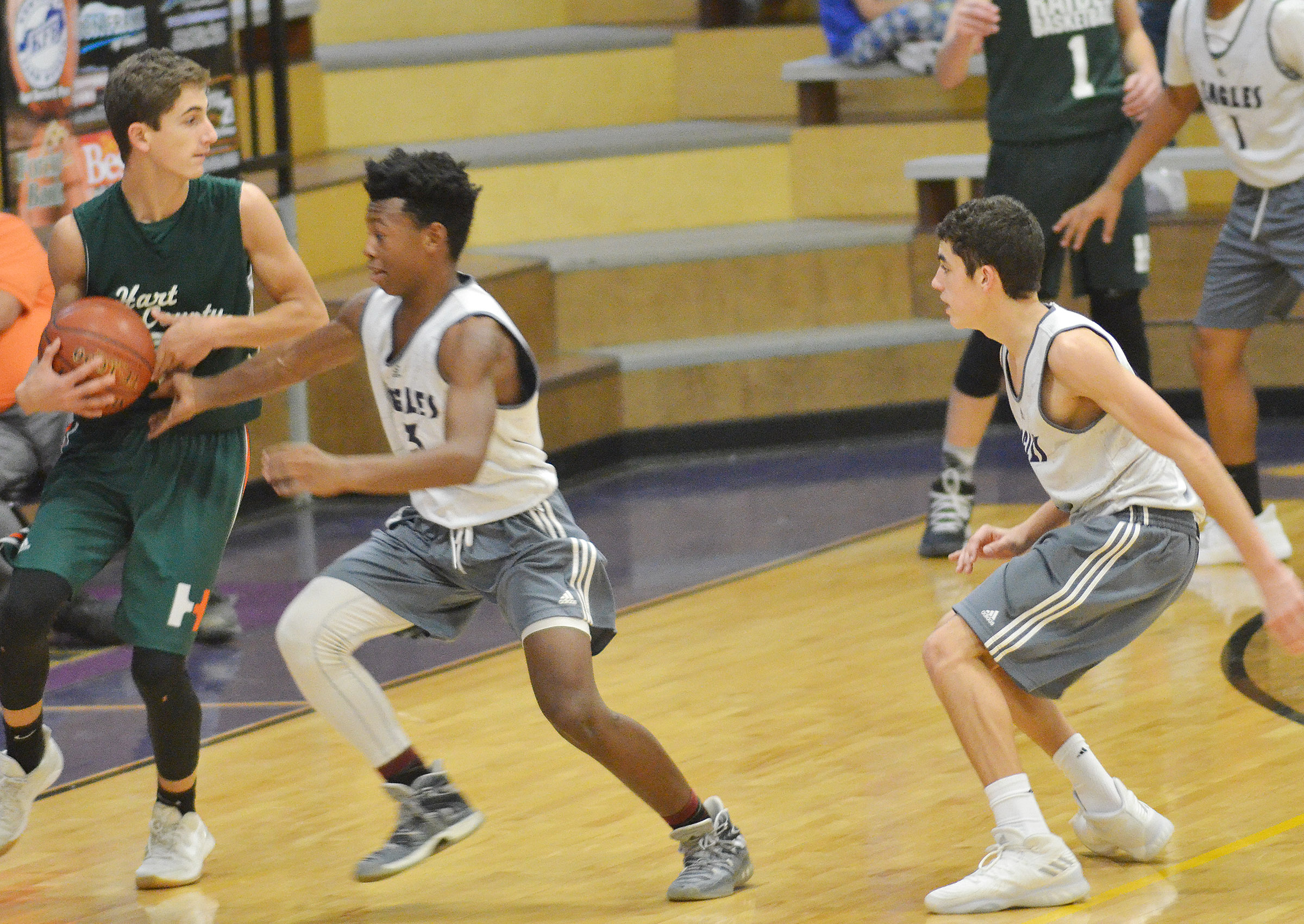 CHS freshmen Sae'von Buckner, at left, and Kameron Smith play defense.