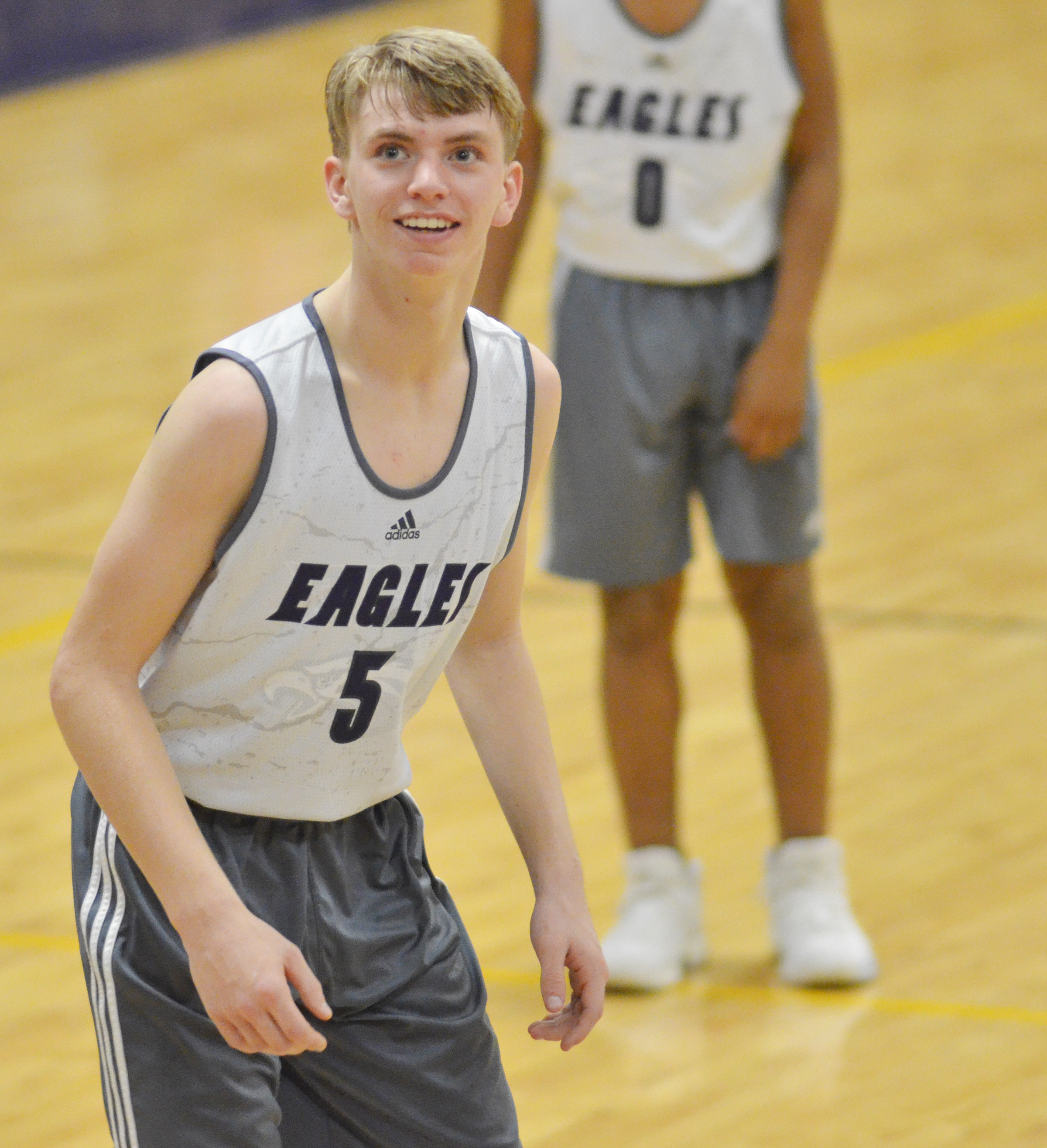 CHS freshman Arren Hash smiles as he watches a teammate shoot the ball.