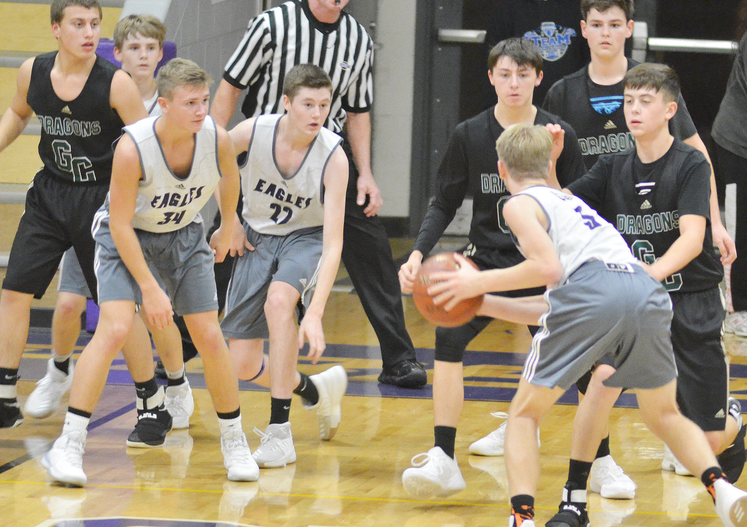 CHS freshman Arren Hash looks to pass as his teammates Blase Wheatley, at left, and Tristin Faulkner, also freshmen, block for him.