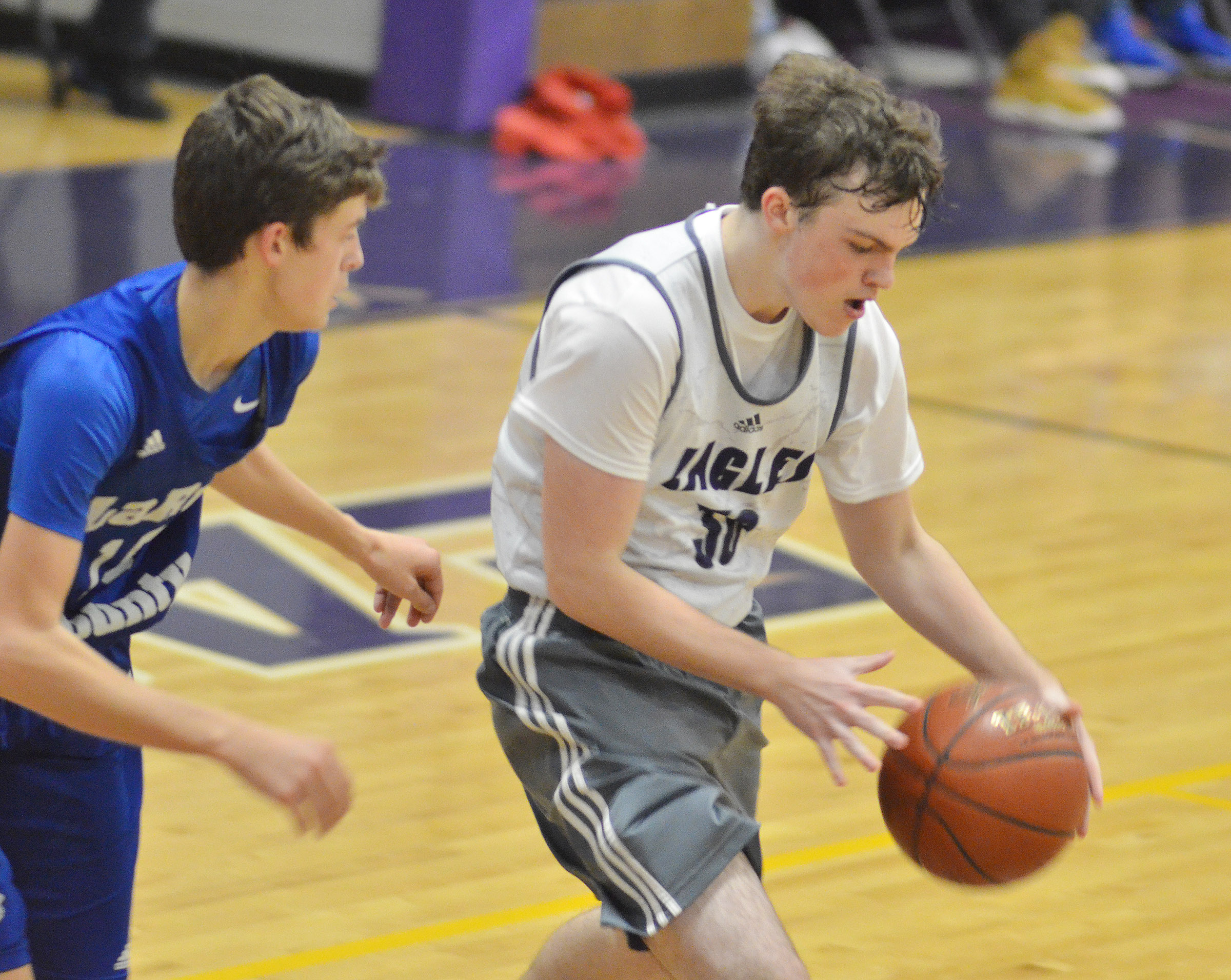 CHS sophomore Jimmy Russell dribbles to the basket.