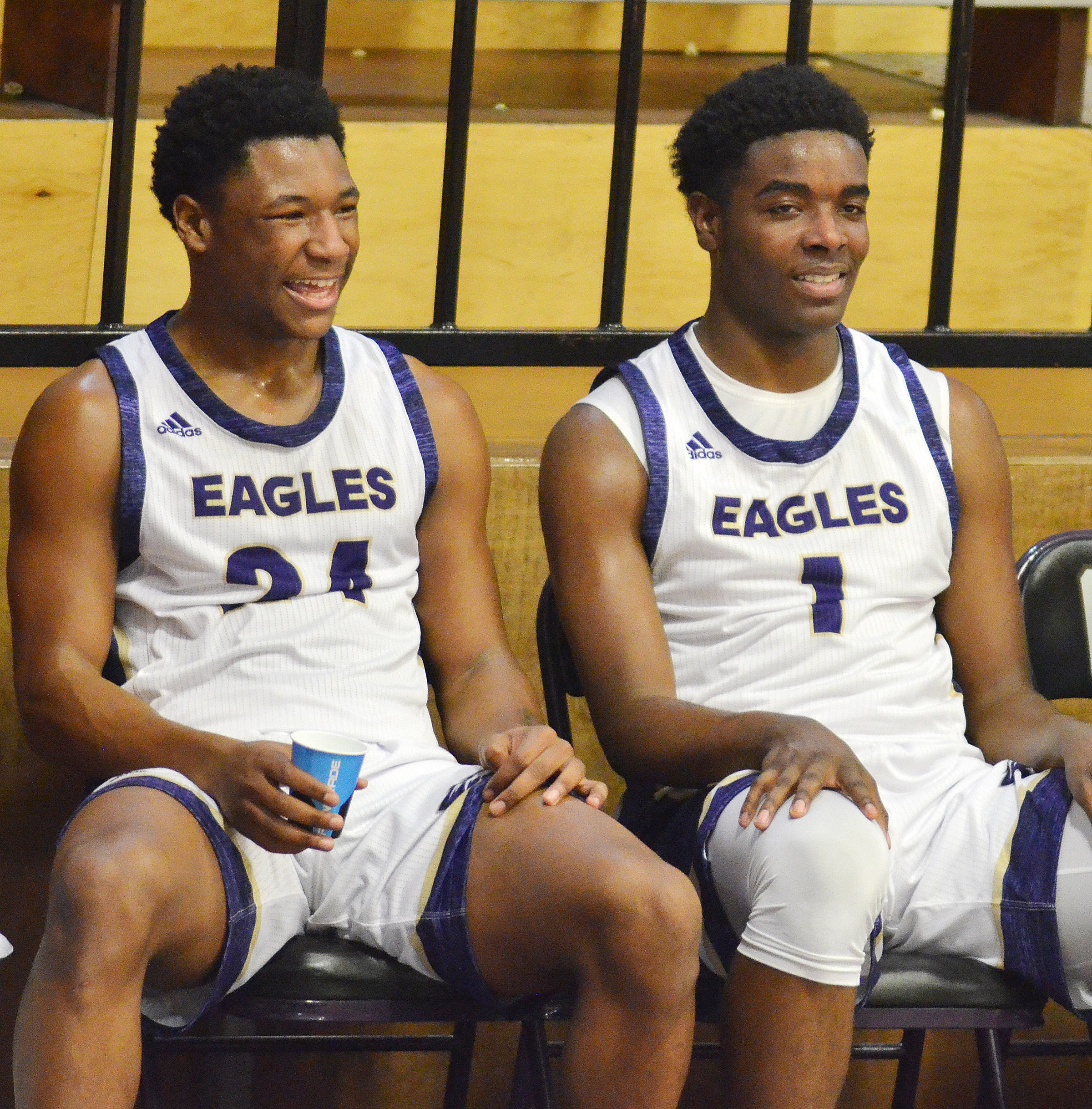 CHS junior Taj Sanders, at left, and senior Chanson Atkinson share a laugh while taking a break.