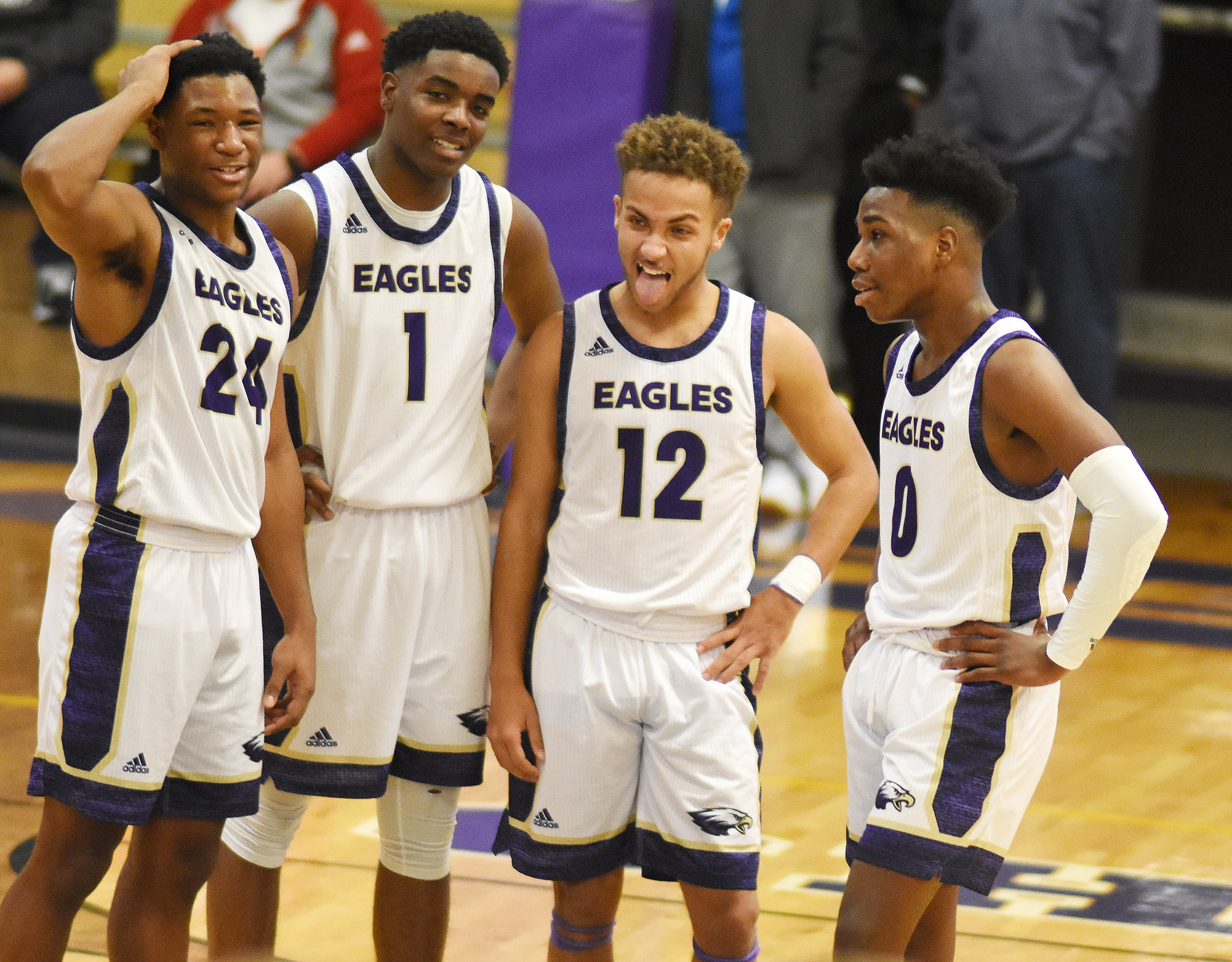 From left, CHS junior Taj Sanders, seniors Chanson Atkinson and Ethan Lay and sophomore Malachi Corley share a laugh during a timeout.
