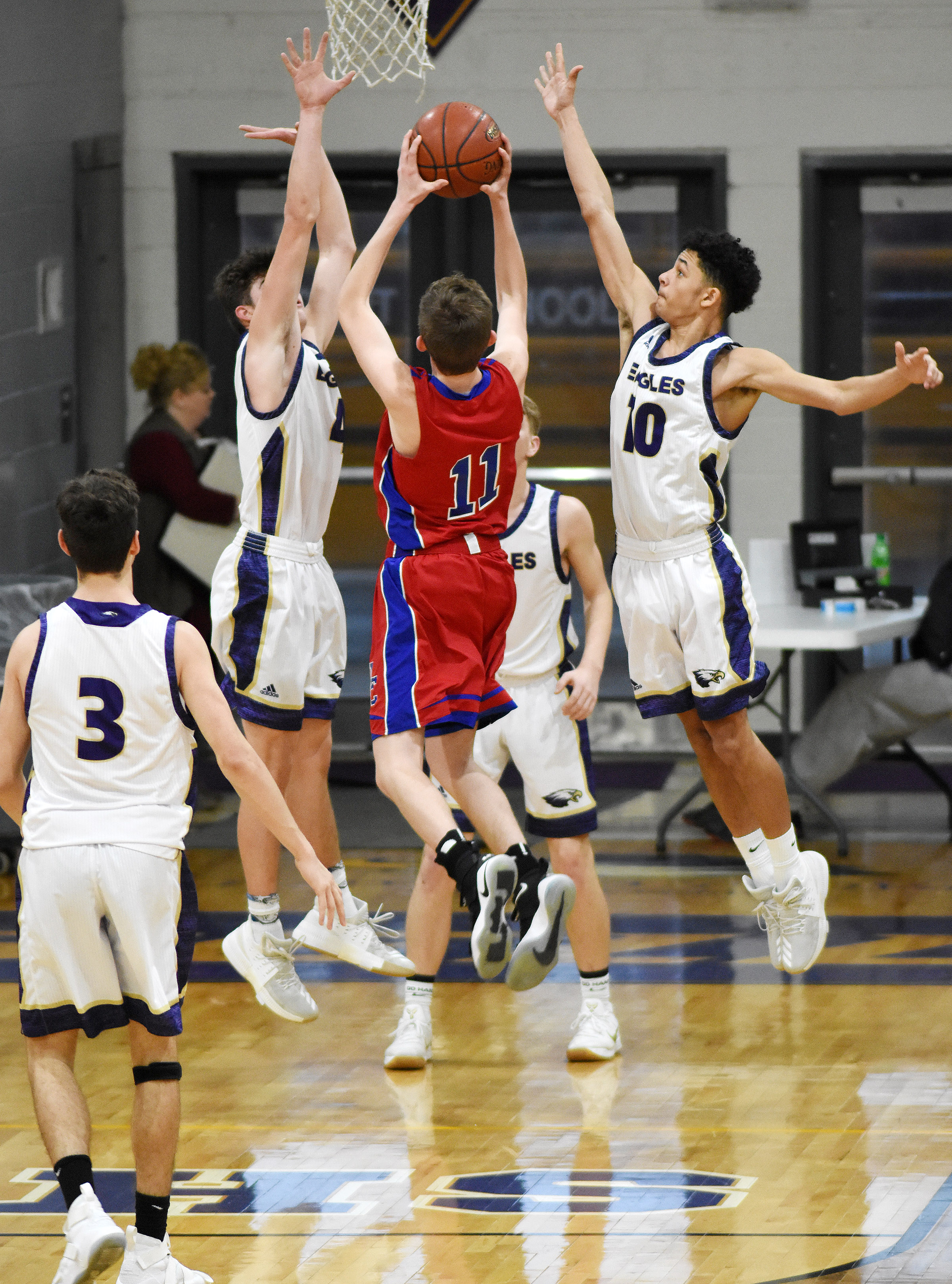 CHS sophomores Mark Rigsby, at left, and Mikael Vaught jump to block a shot.