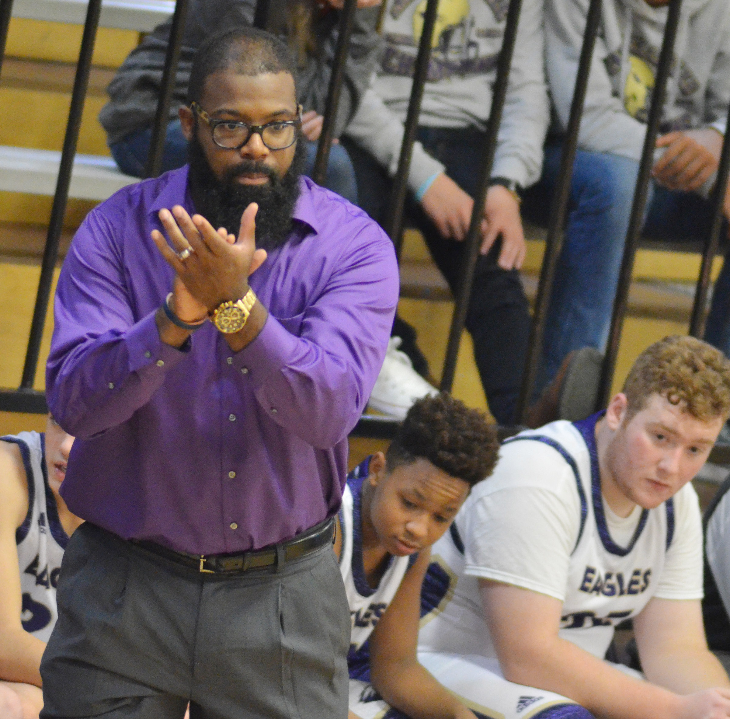 CHS boys' basketball assistant coach Will Griffin claps after a call.