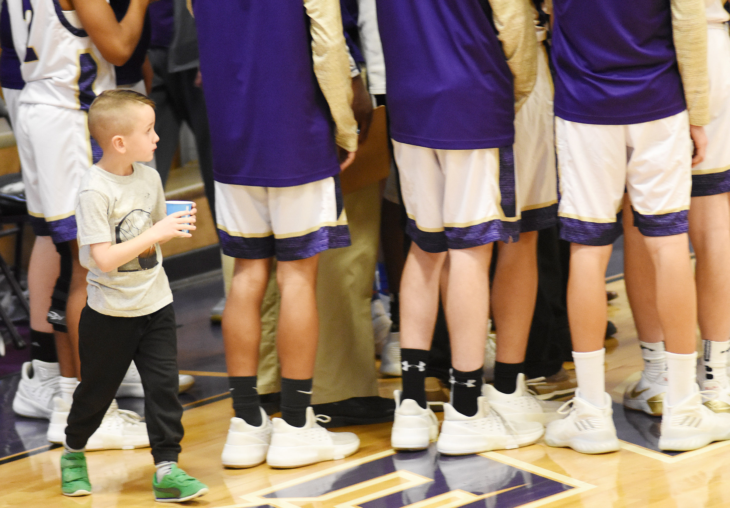 Campbellsville Elementary School kindergartener Cash Davis delivers water to the players.