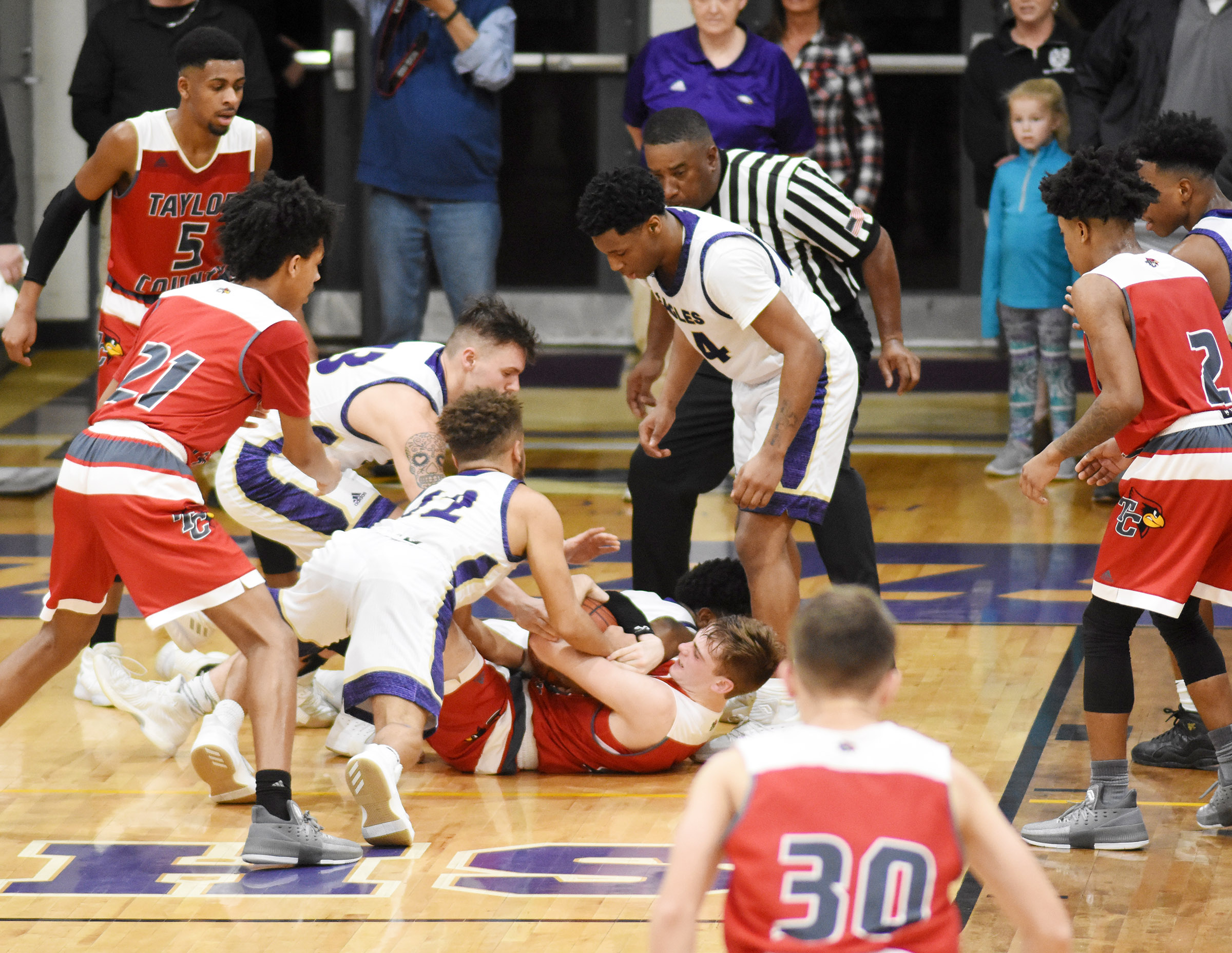 From left, CHS seniors Logan Cole and Ethan Lay and junior Taj Sanders fight for the ball.
