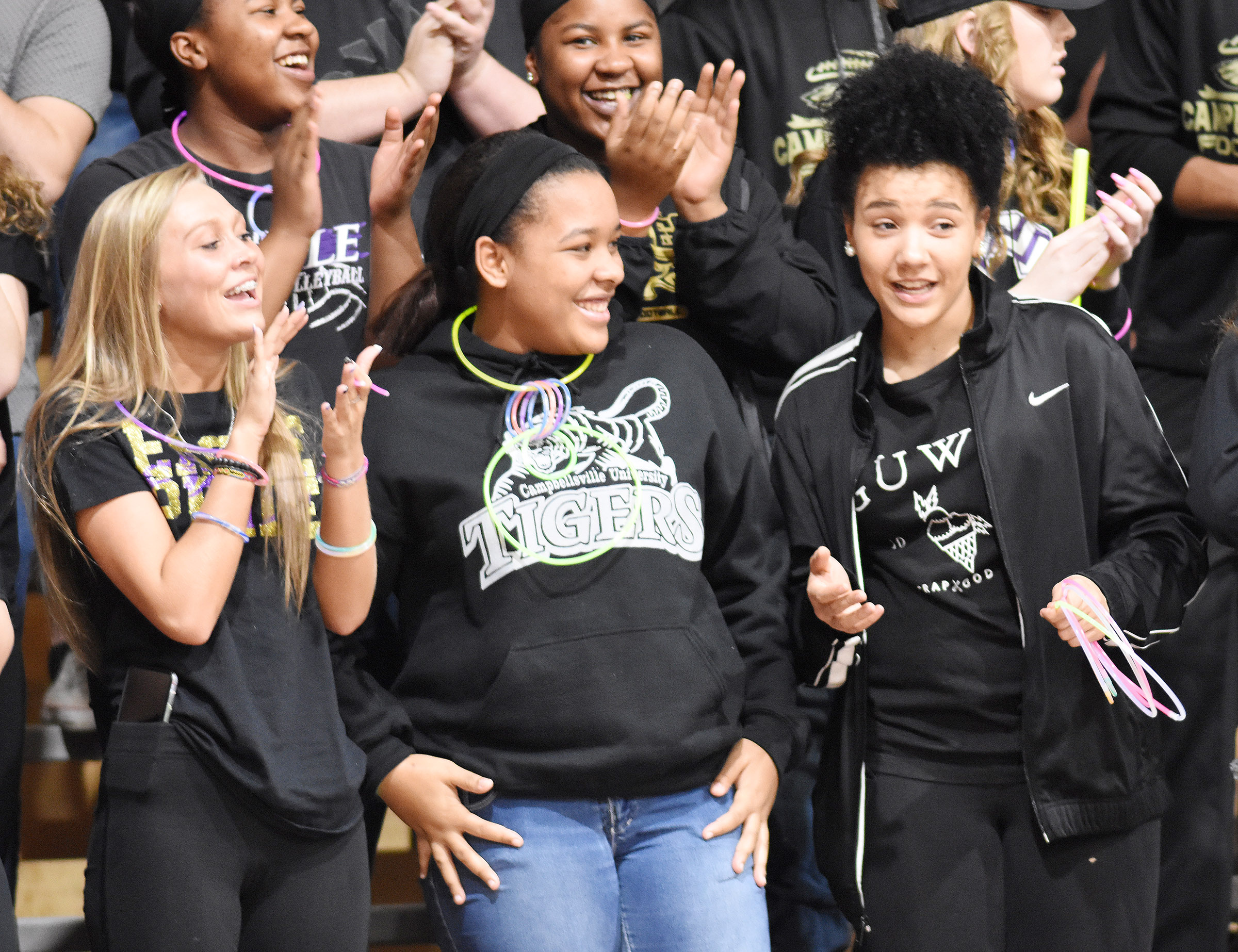 CHS students cheer for the Eagles. From left are junior Tatem Wiseman, senior Kayla Young and junior Kalisha Murphy.