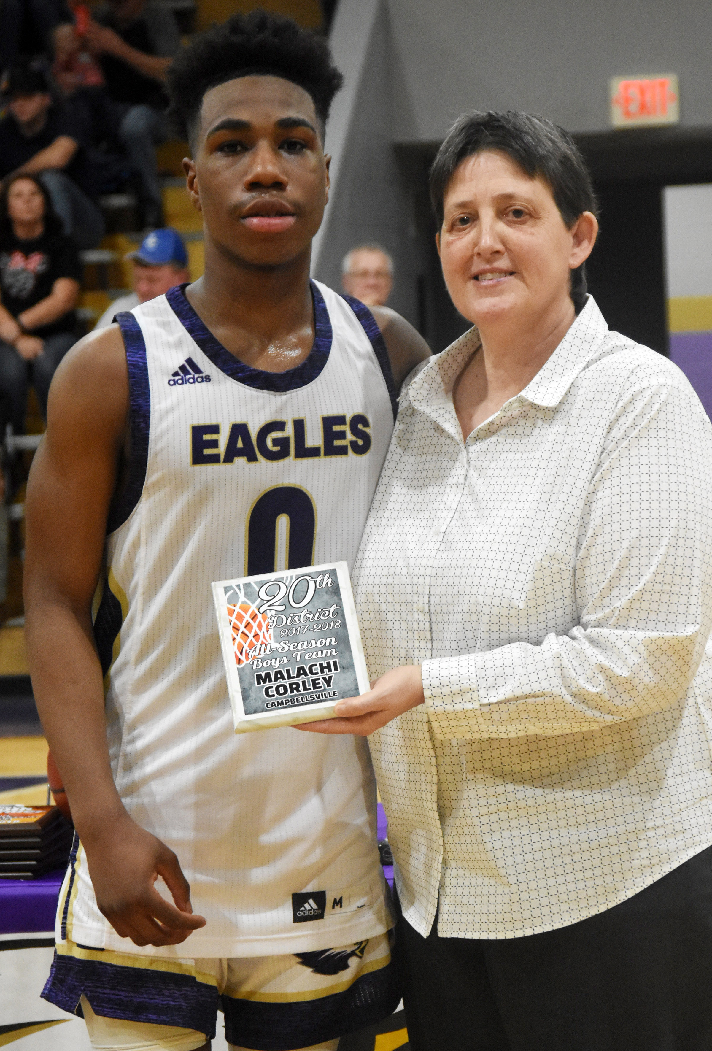 CHS sophomore Malachi Corley receives an all-season award from CHS Assistant Athletic Director Katie Wilkerson.
