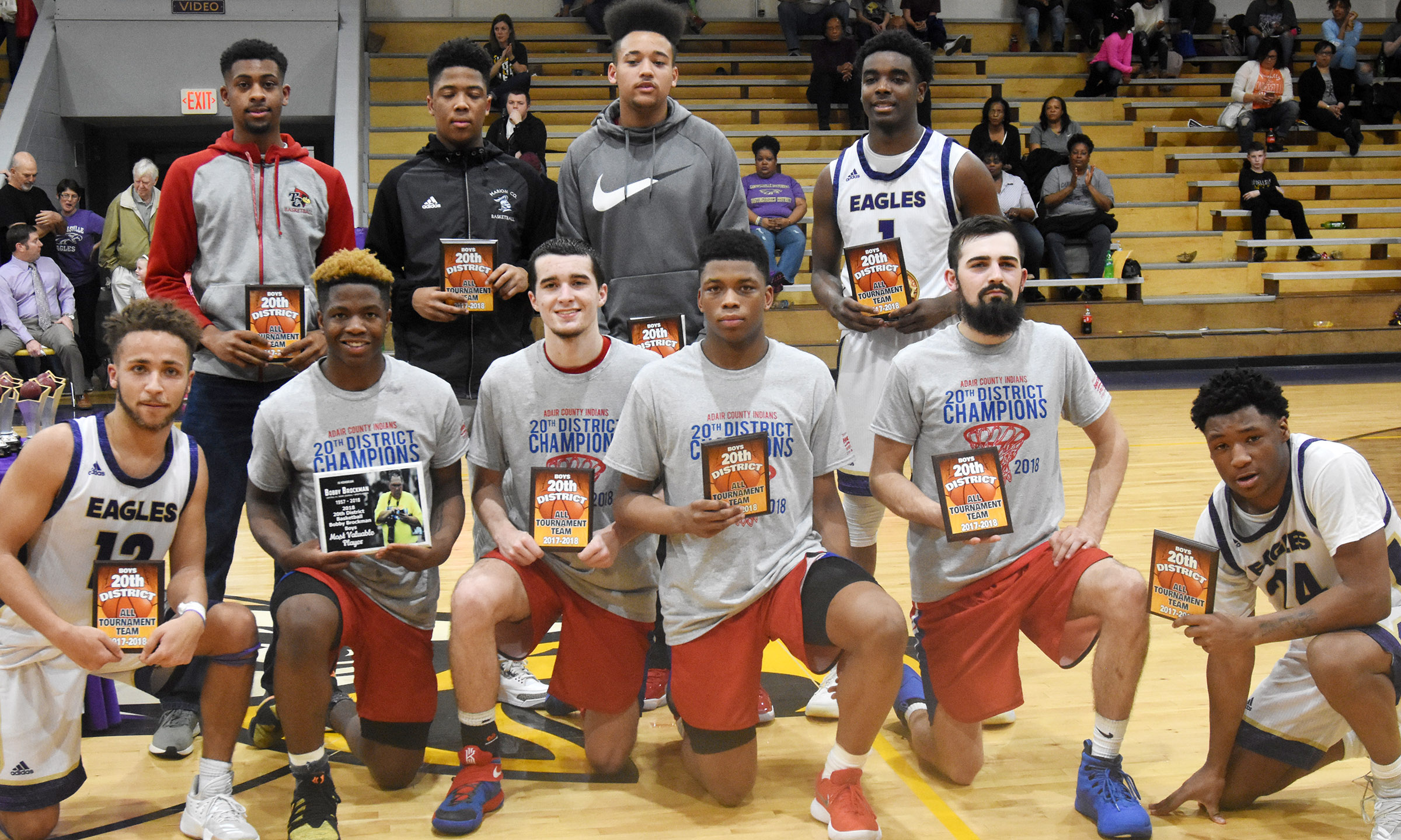 CHS senior Ethan Lay, in front, at left, Taj Sanders, a junior, in front, at right, and senior Chanson Atkinson, back, at right, receive all-district tournament awards.