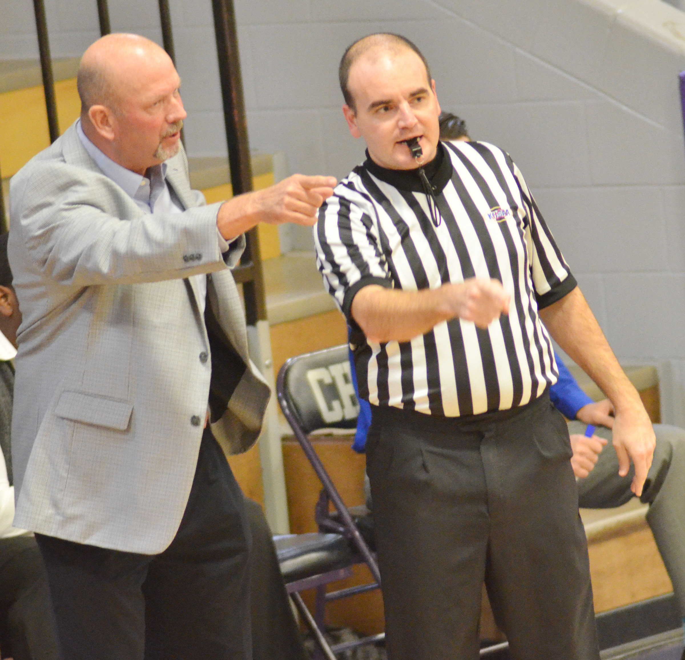 CHS boys' basketball head coach Tim Davis questions a call.