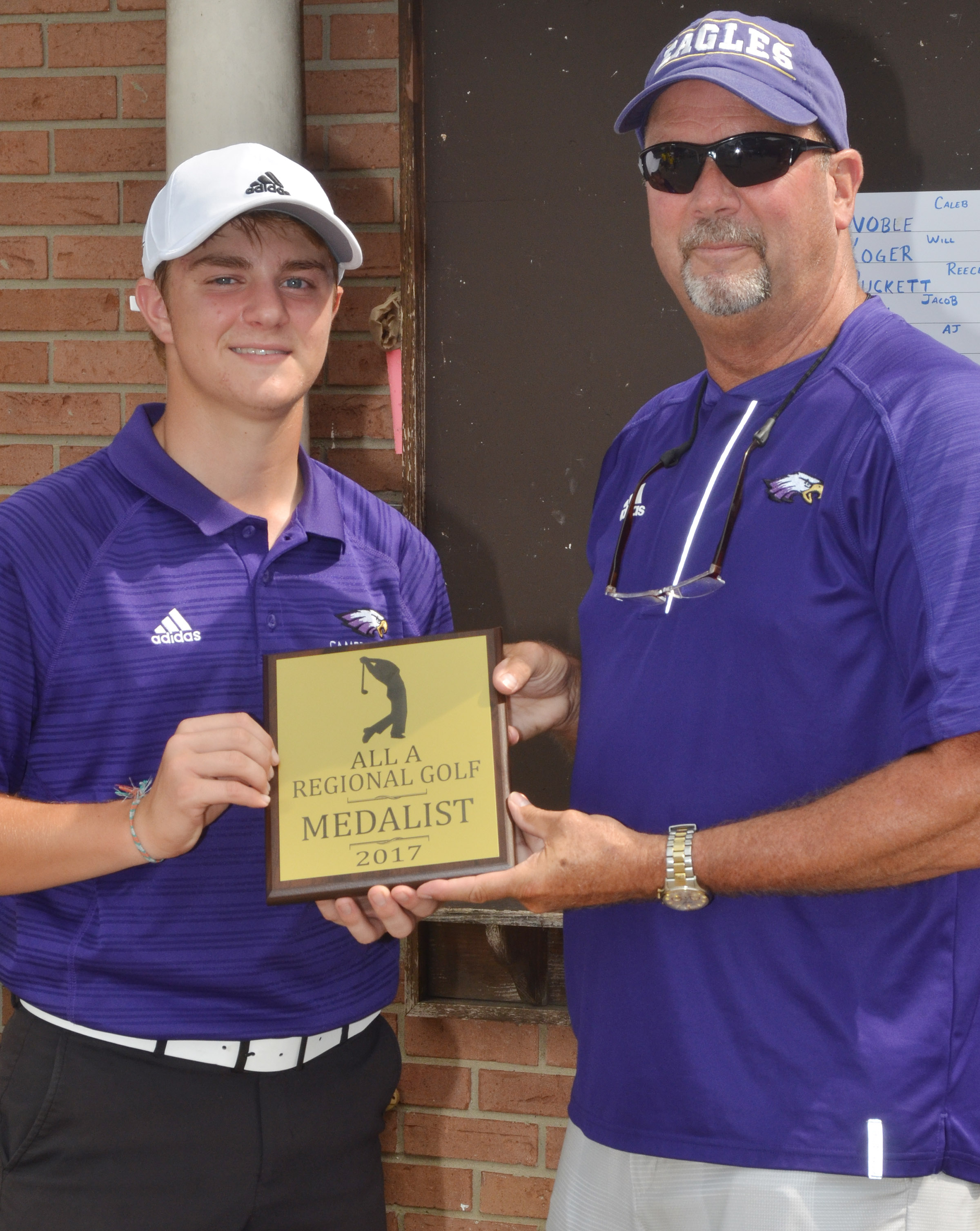 "CHS senior Alex Doss was the overall individual winner in the All ""A"" region tournament. At right is CHS Athletic Director Tim Davis."
