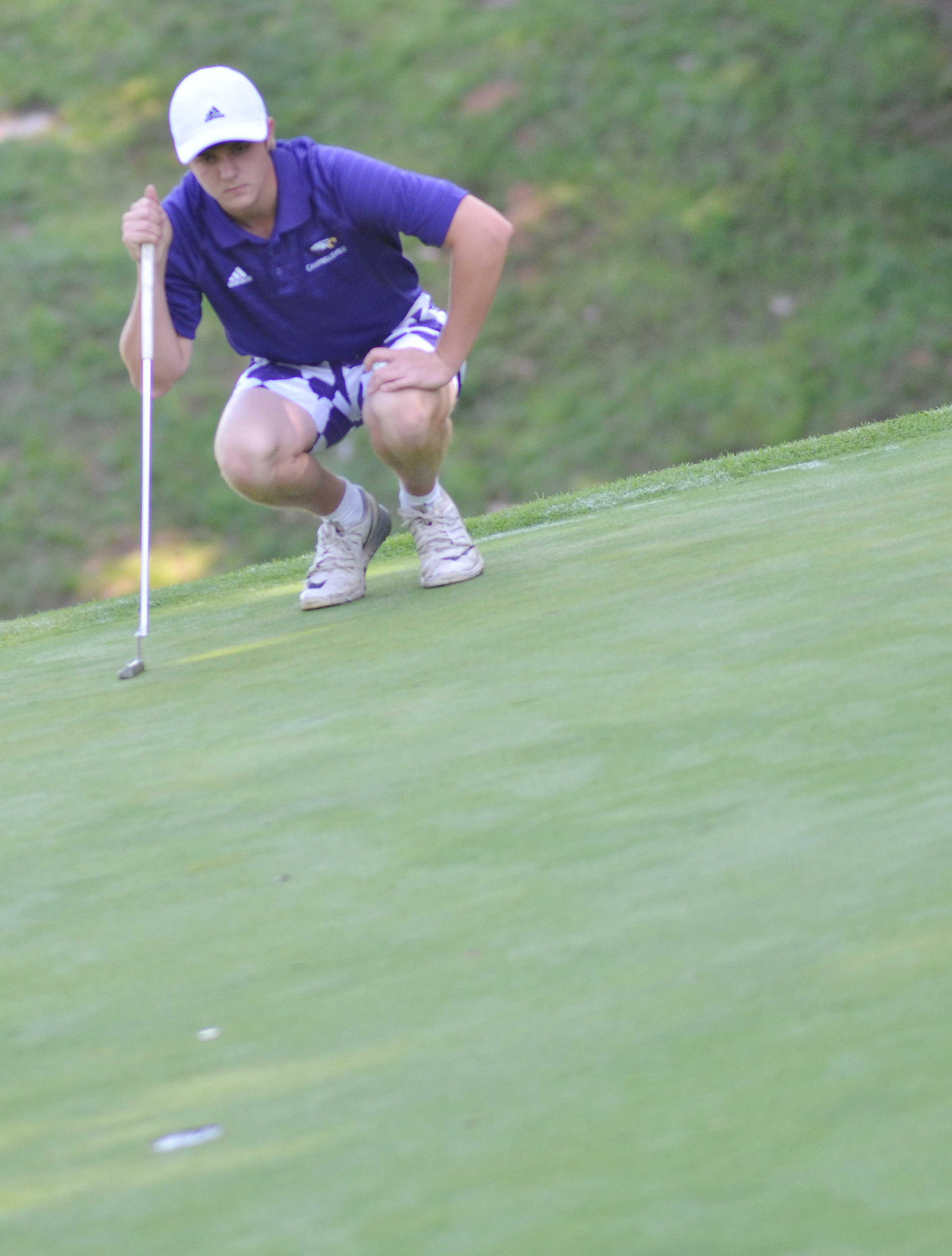 CHS senior Alex Doss lines up a putt.