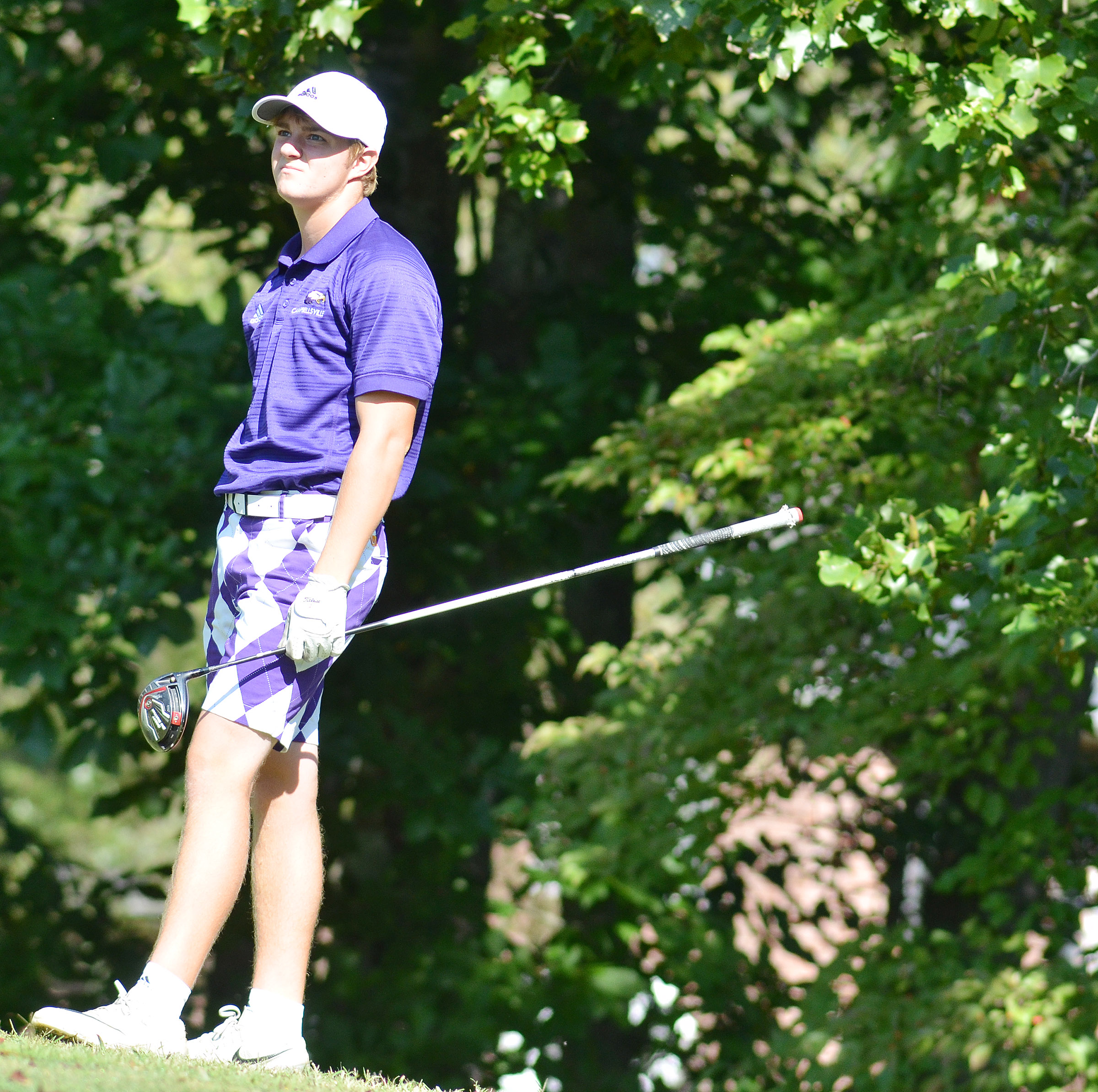 CHS senior Alex Doss watches his ball land.