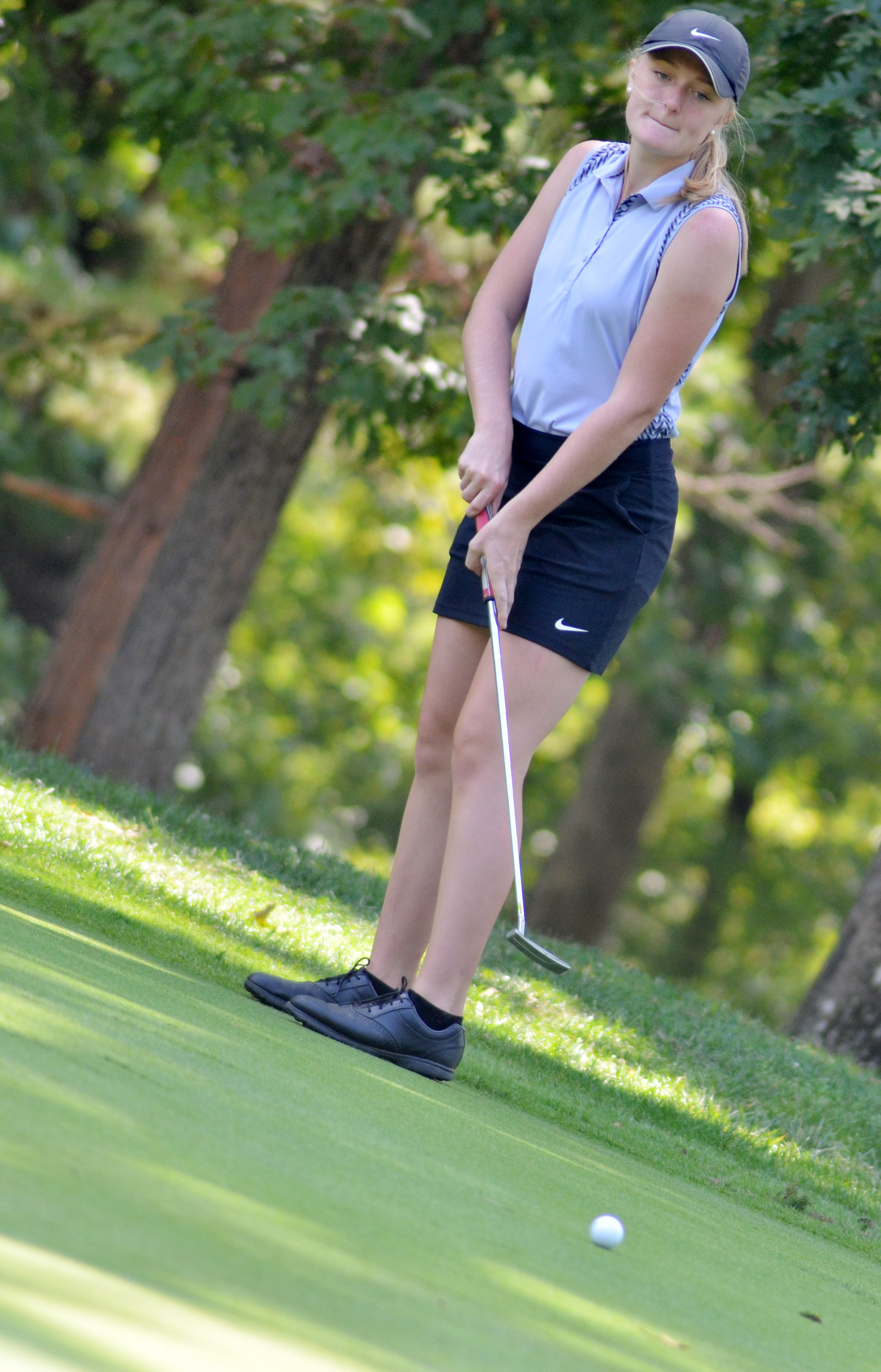 CHS junior Abbie Dicken sinks a putt.