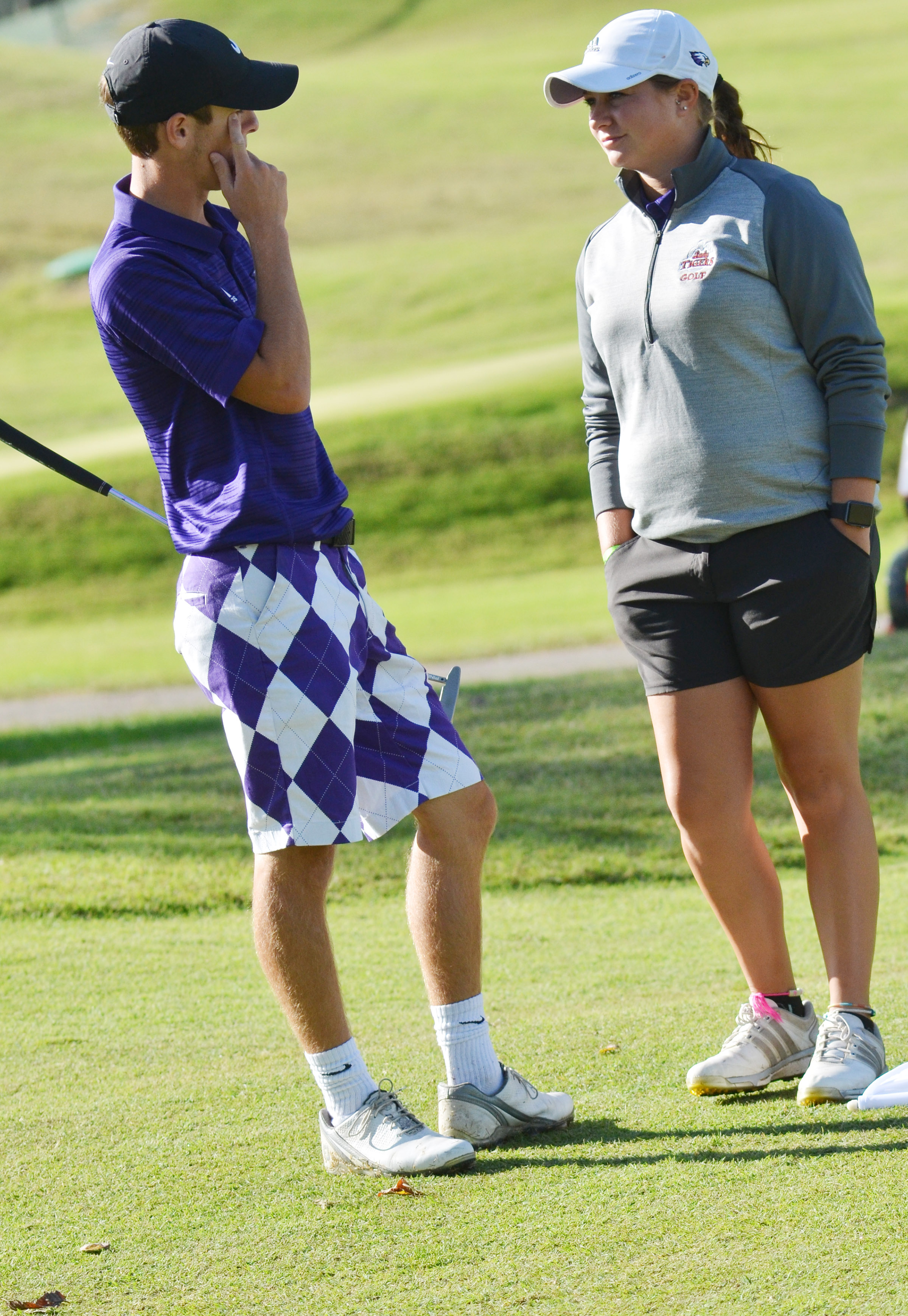 CHS junior Layton Hord talks with coach Cassidy Decker before a shot.
