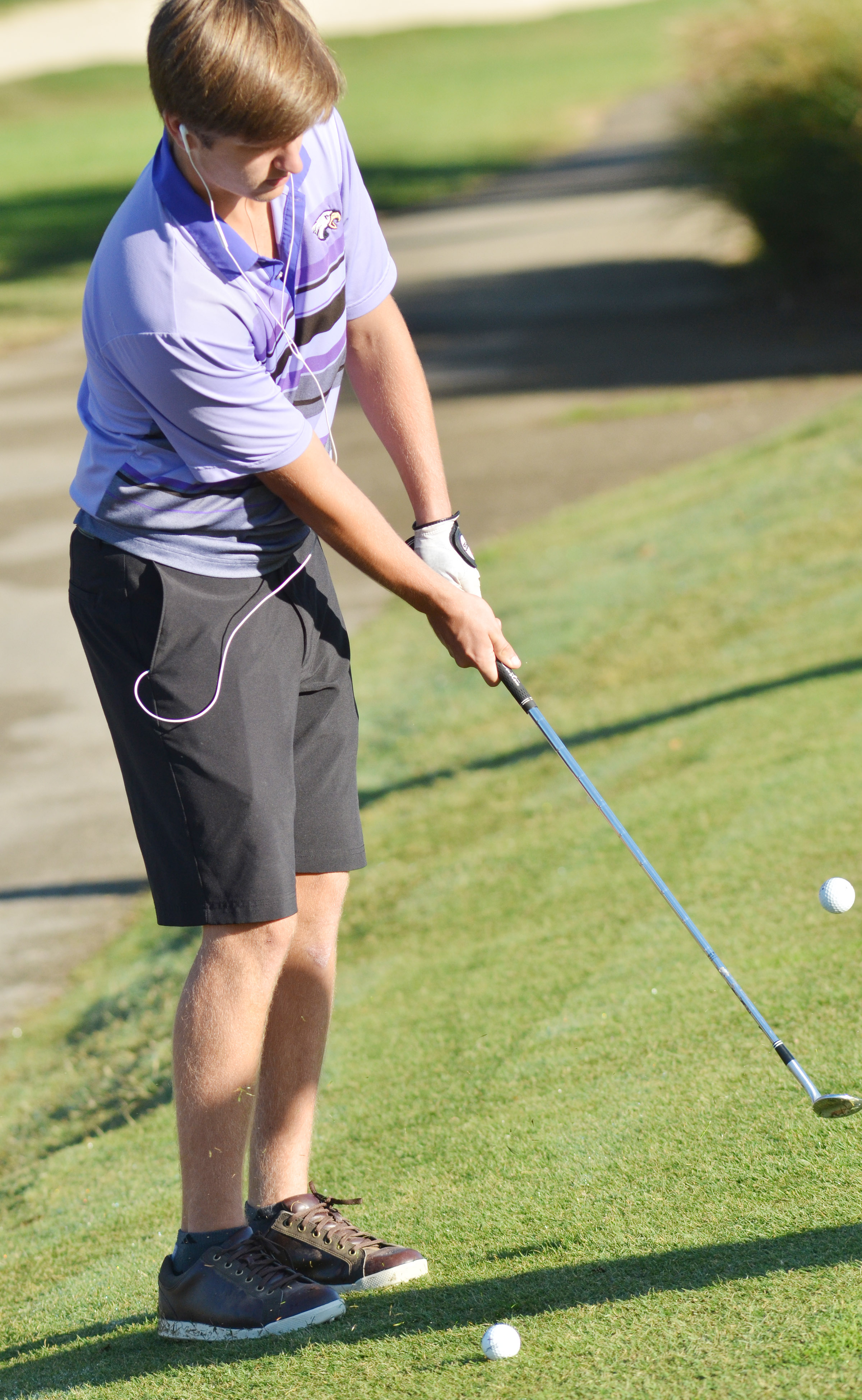 CHS junior Myles Murrell practices chipping.