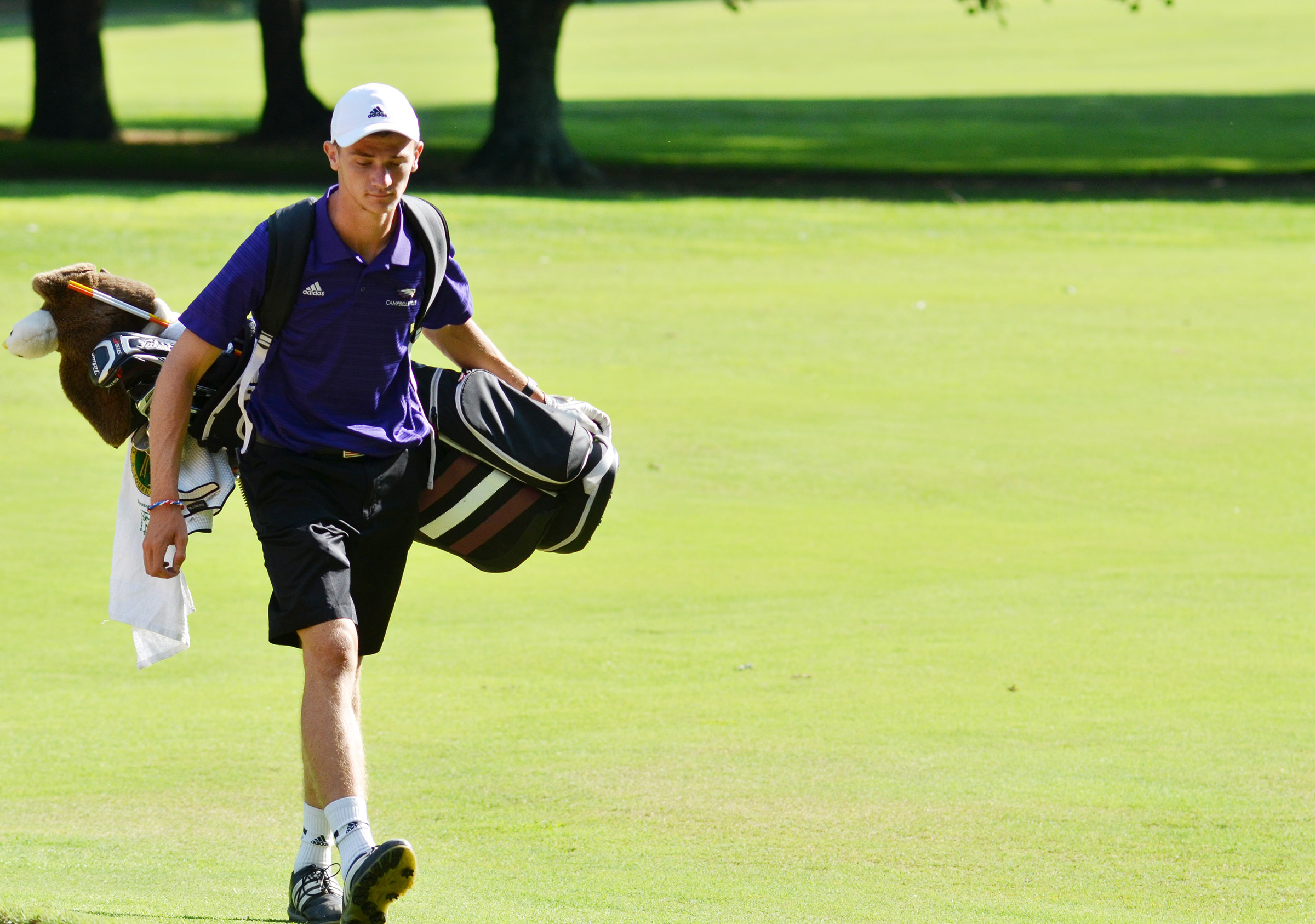 CHS senior Connor Wilson walks to the putting green.