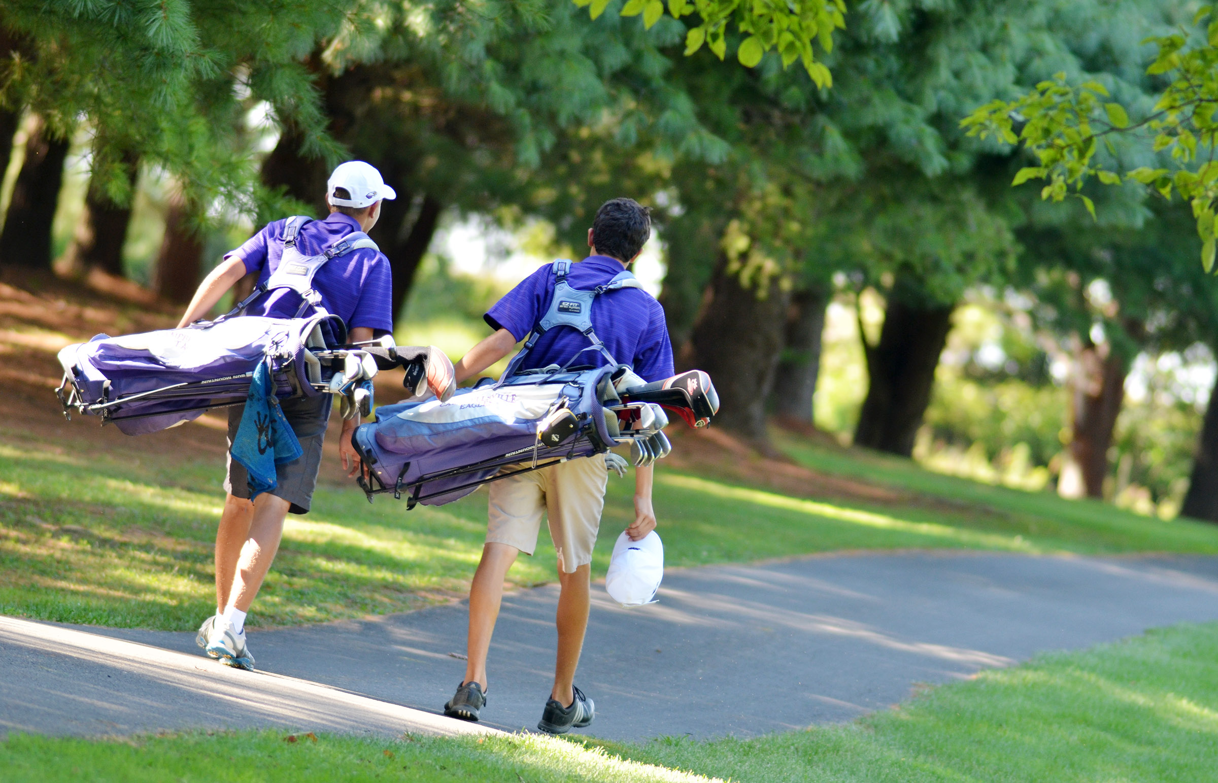 CHS junior Casey Hardin, at left, and freshman Kameron Smith walk to the putting green.