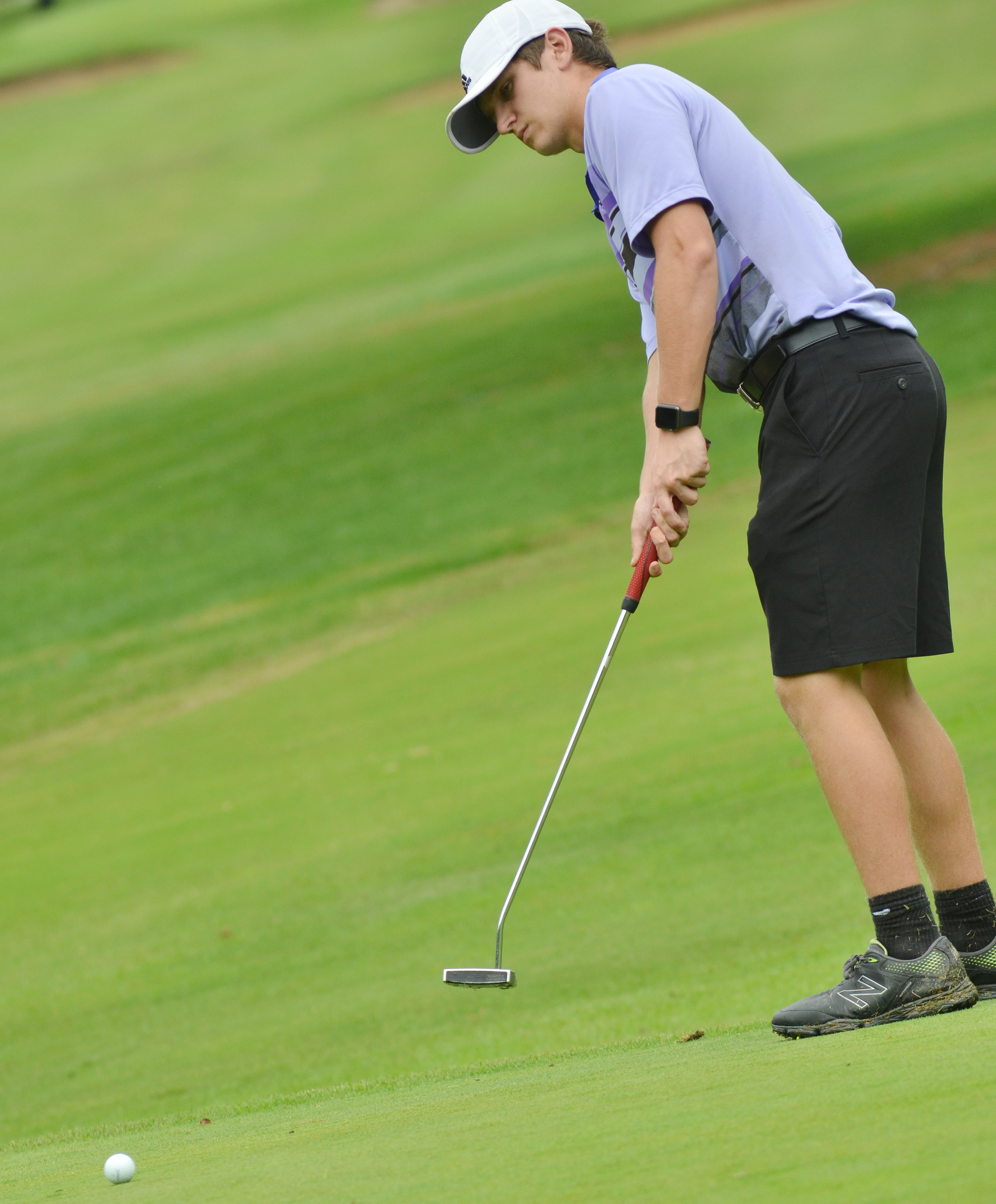 CHS junior Myles Murrell putts.