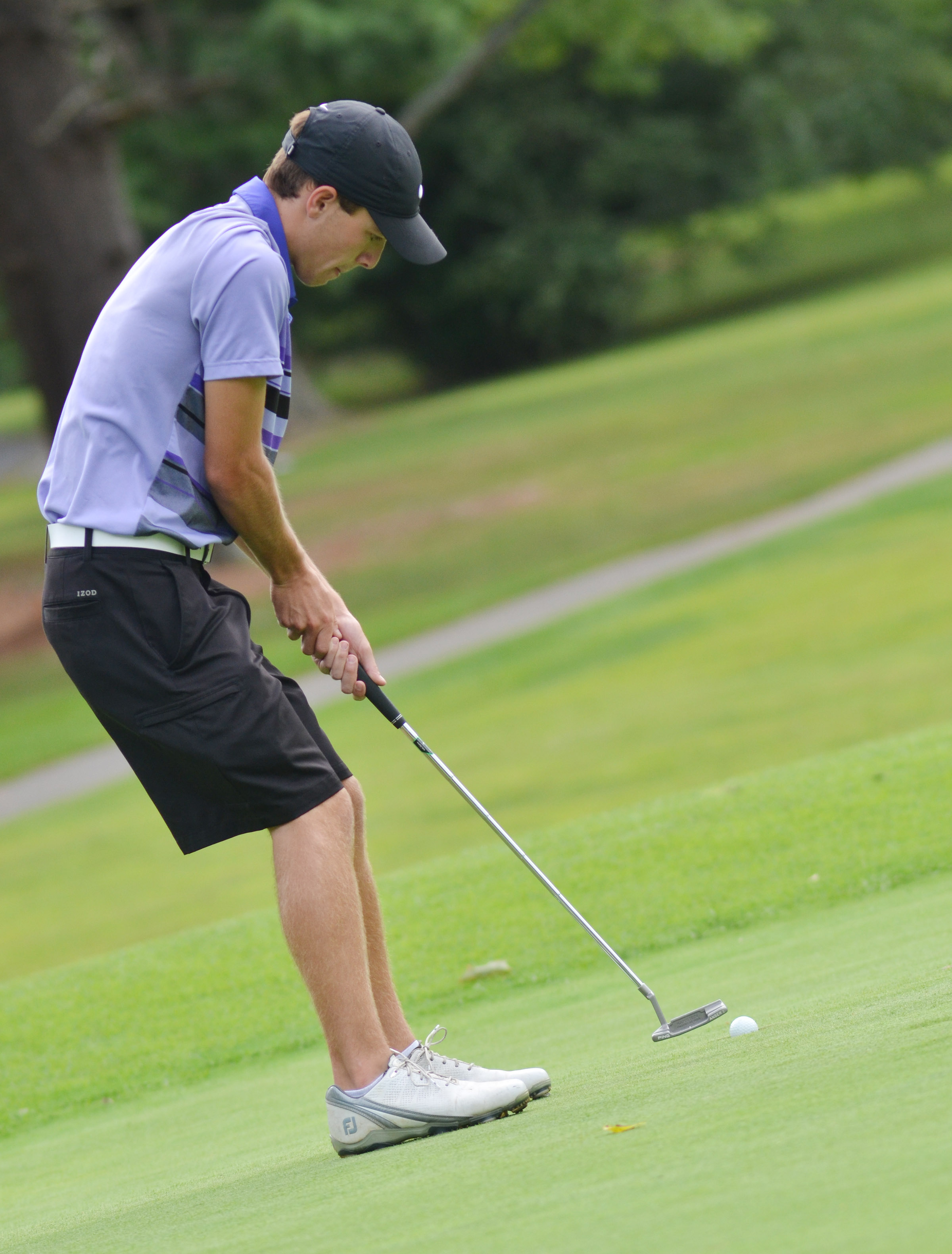 CHS junior Layton Hord sinks a putt.