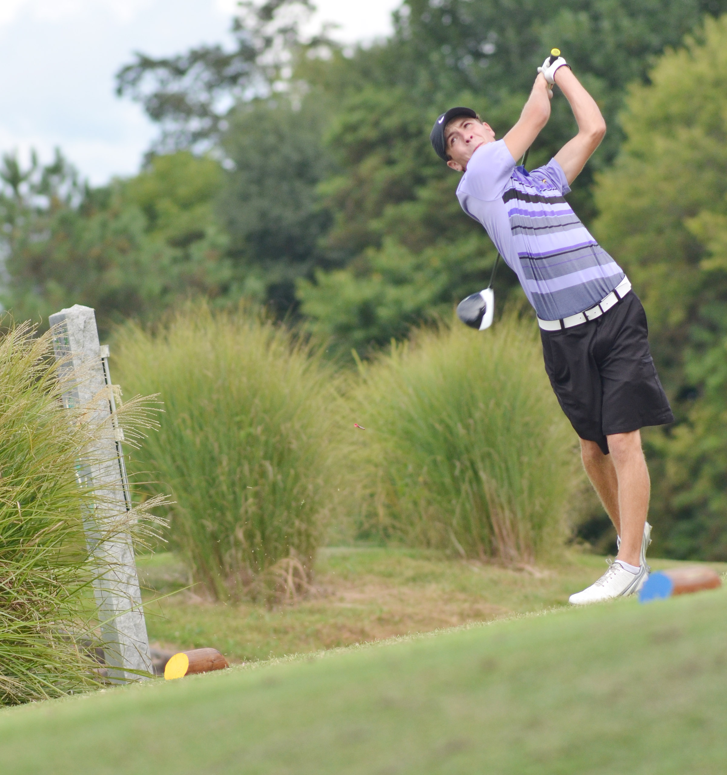 CHS junior Layton Hord tees off.