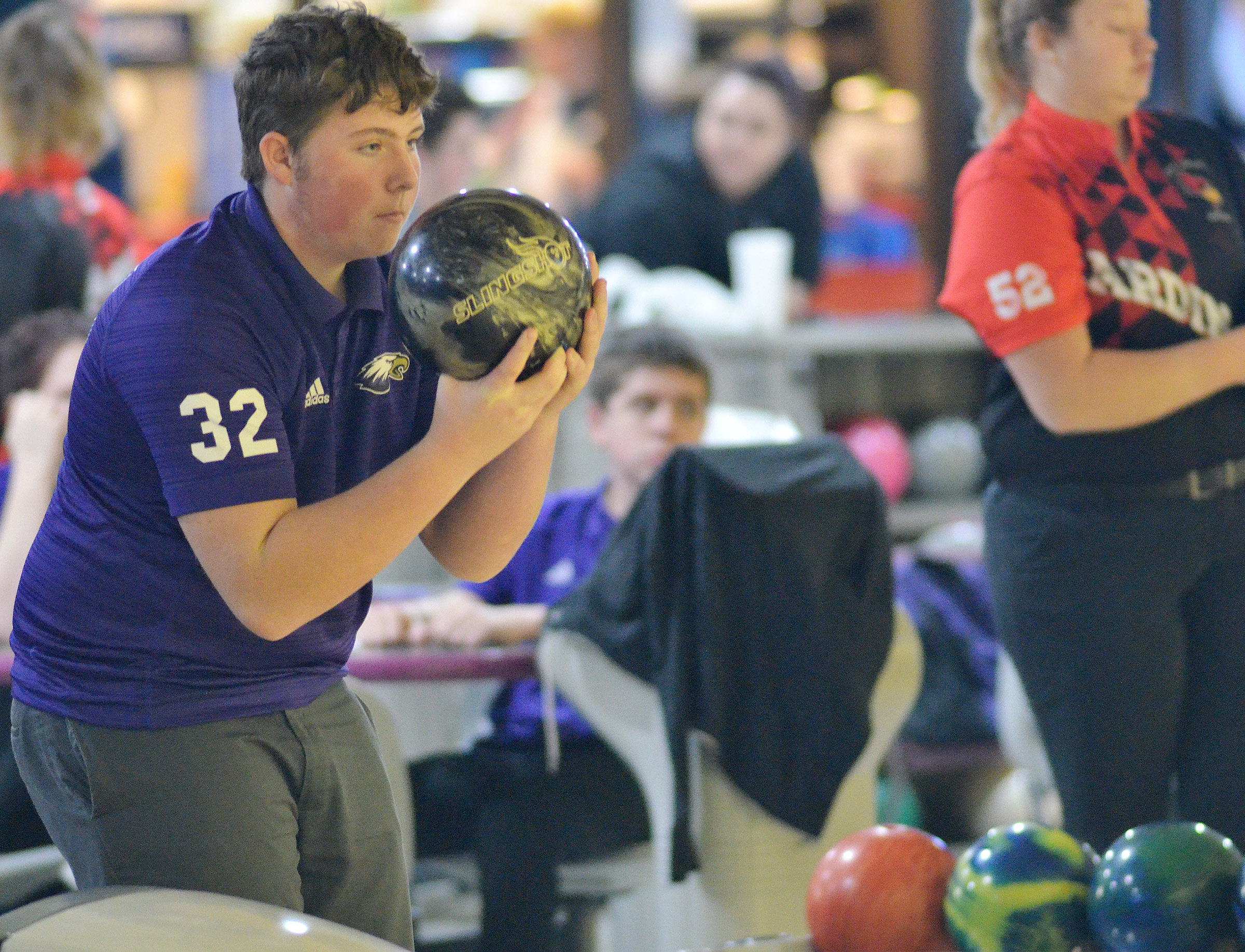 CHS freshman Alex Howard bowls.