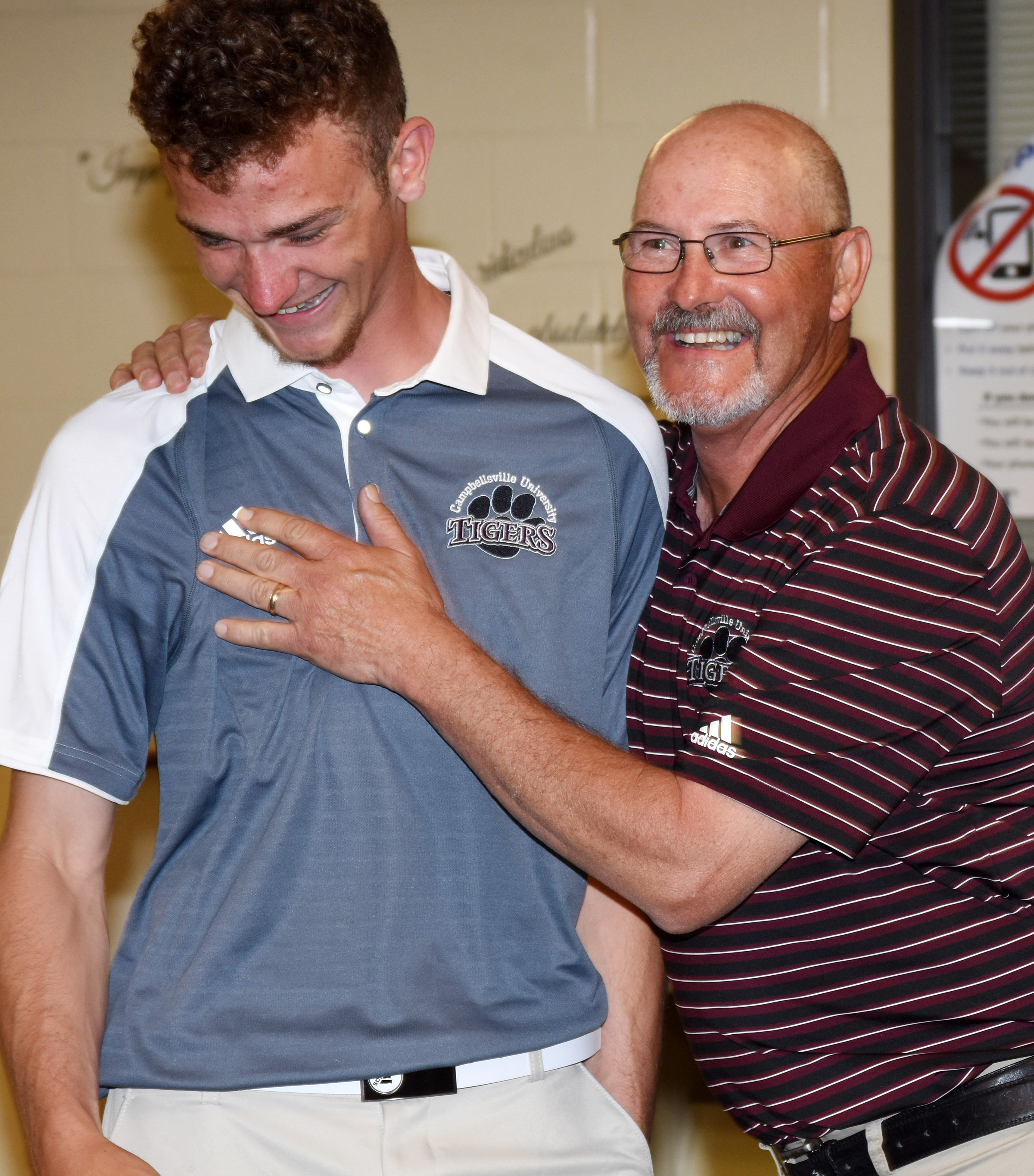 Campbellsville University men's golf head coach Jim Ward congratulates CHS senior Connor Wilson, who will once again play on his team. Ward coached Wilson for two years during his high school playing career.