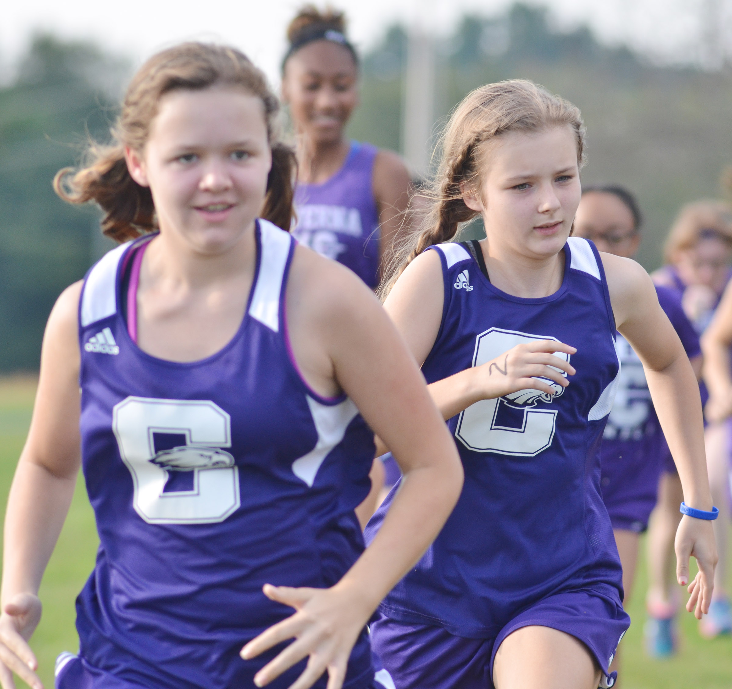 CMS seventh-grader MaCayla Falls, at left, and eighth-grader Serenity Ford run.