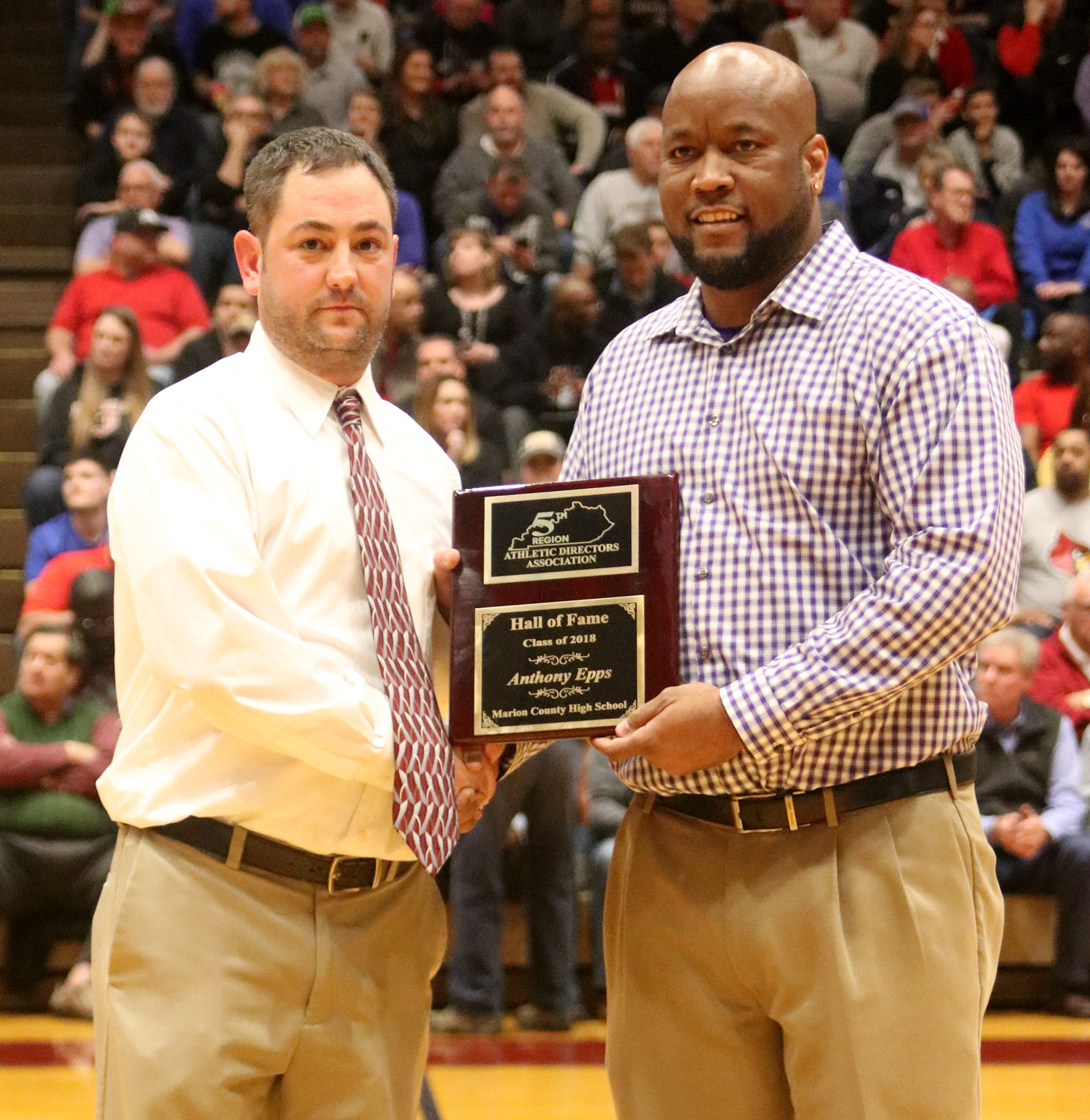 CHS girls' basketball head coach Anthony Epps, at right, was induced into the 5th Region Athletic Director's Hall of Fame in a special ceremony at Marion County High School on Tuesday, March 6. Michael Holt, athletic director at Marion County, made the presentation.