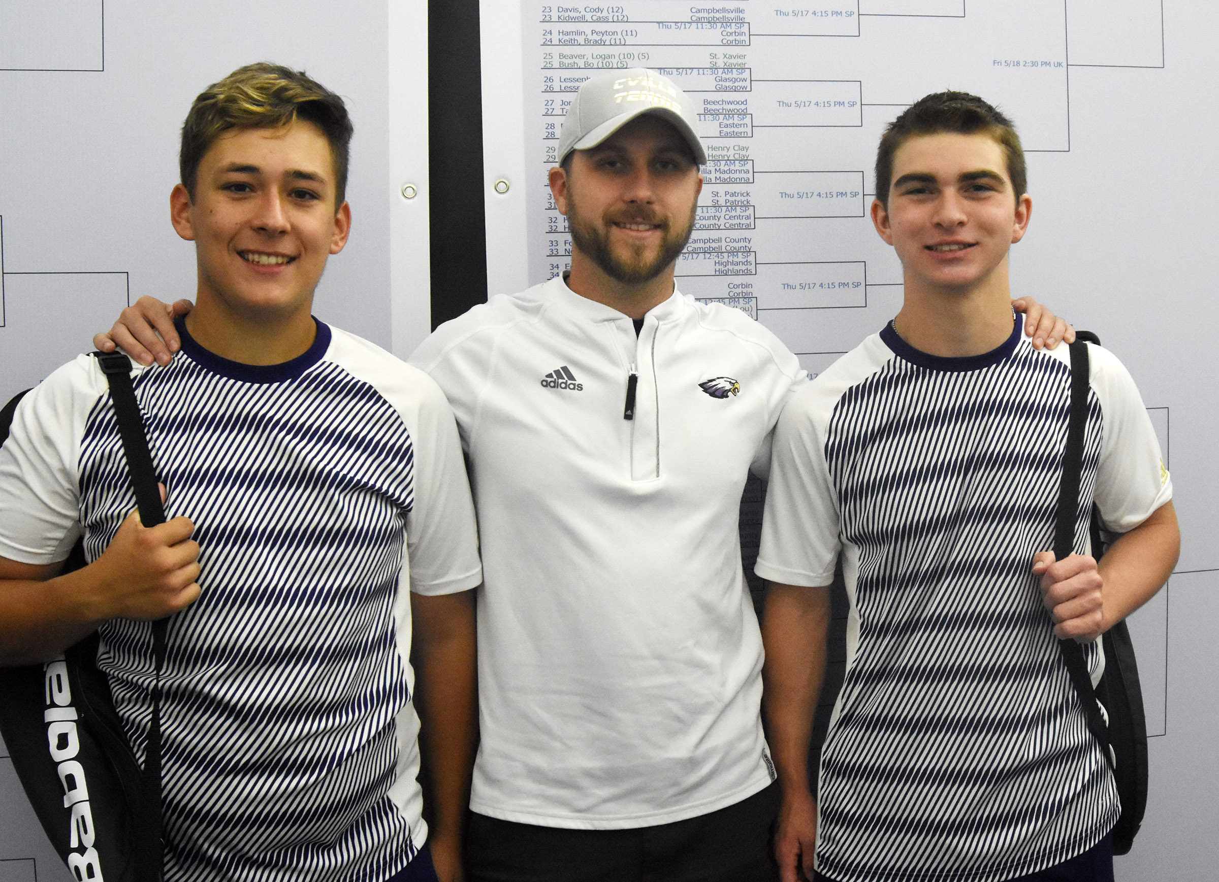 Campbellsville High School seniors Cody Davis, at left, and Cass Kidwell, at right, made school history recently, playing in the state tennis tournament on Thursday, May 17. Davis and Kidwell are the first CHS boys' tennis players to compete at the state tournament since 2002. They are pictured with boys' tennis coach Tyler Hardy.