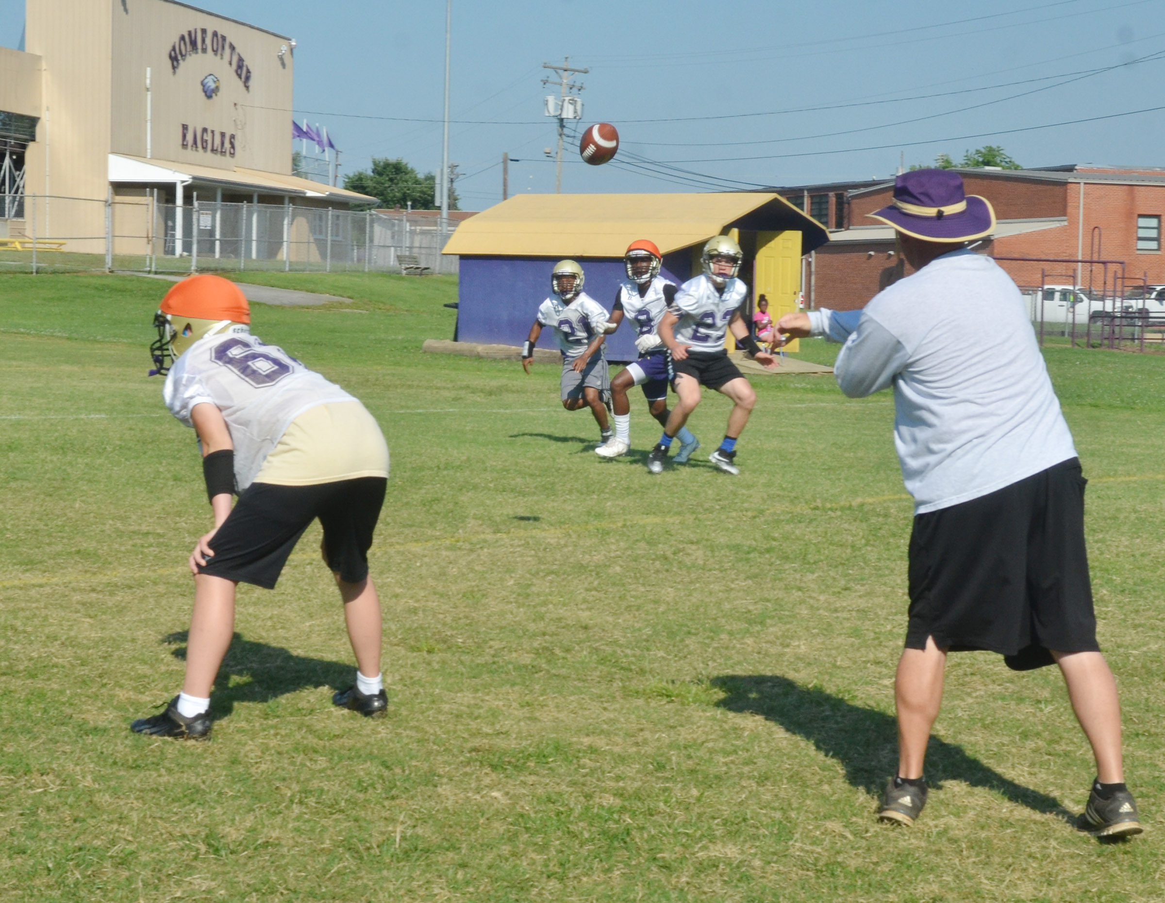 CHS head football coach Dale Estes throws a pass.