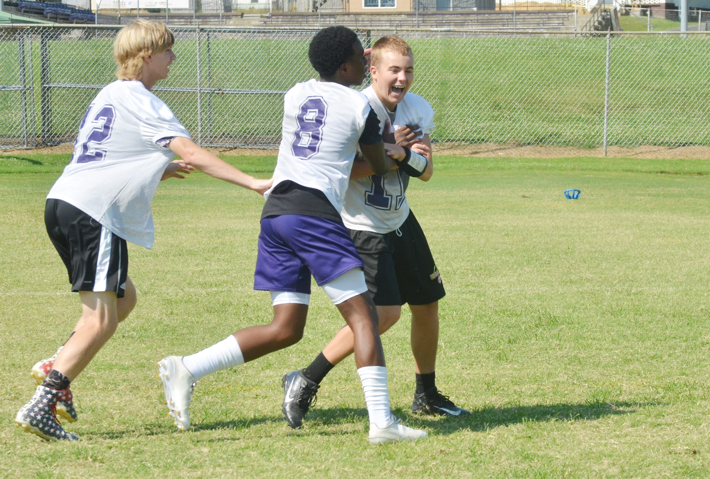 CHS freshman Arren Hash, at left, and sophomore Malachi Corley tackle sophomore Tyler Gribbins.