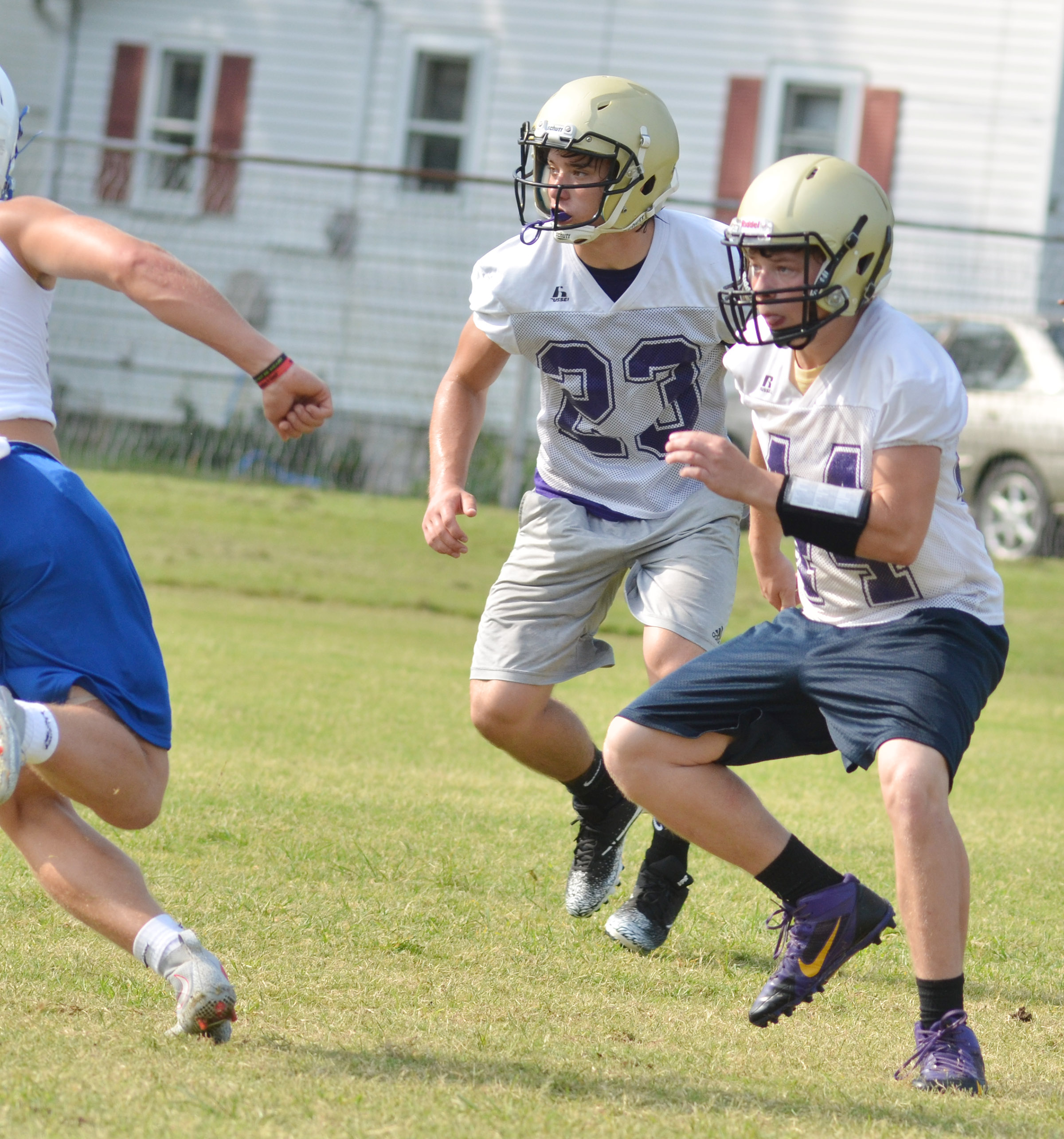 CHS junior Tristan Johnson, at left, and sophomore Devon Reardon get set to tackle.