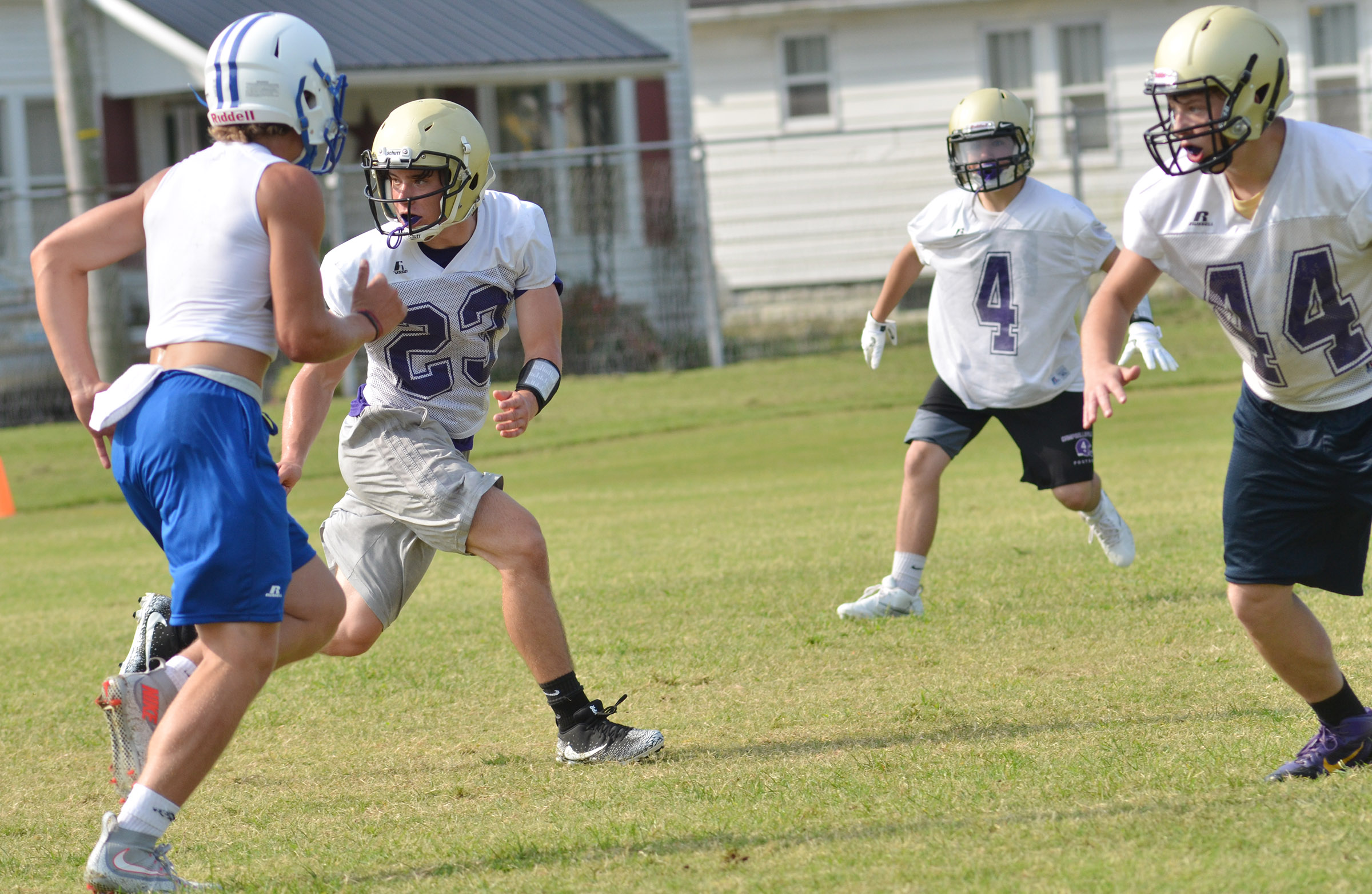From left, CHS junior Tristan Johnson, senior Austin Carter and sophomore Devon Reardon tackle.
