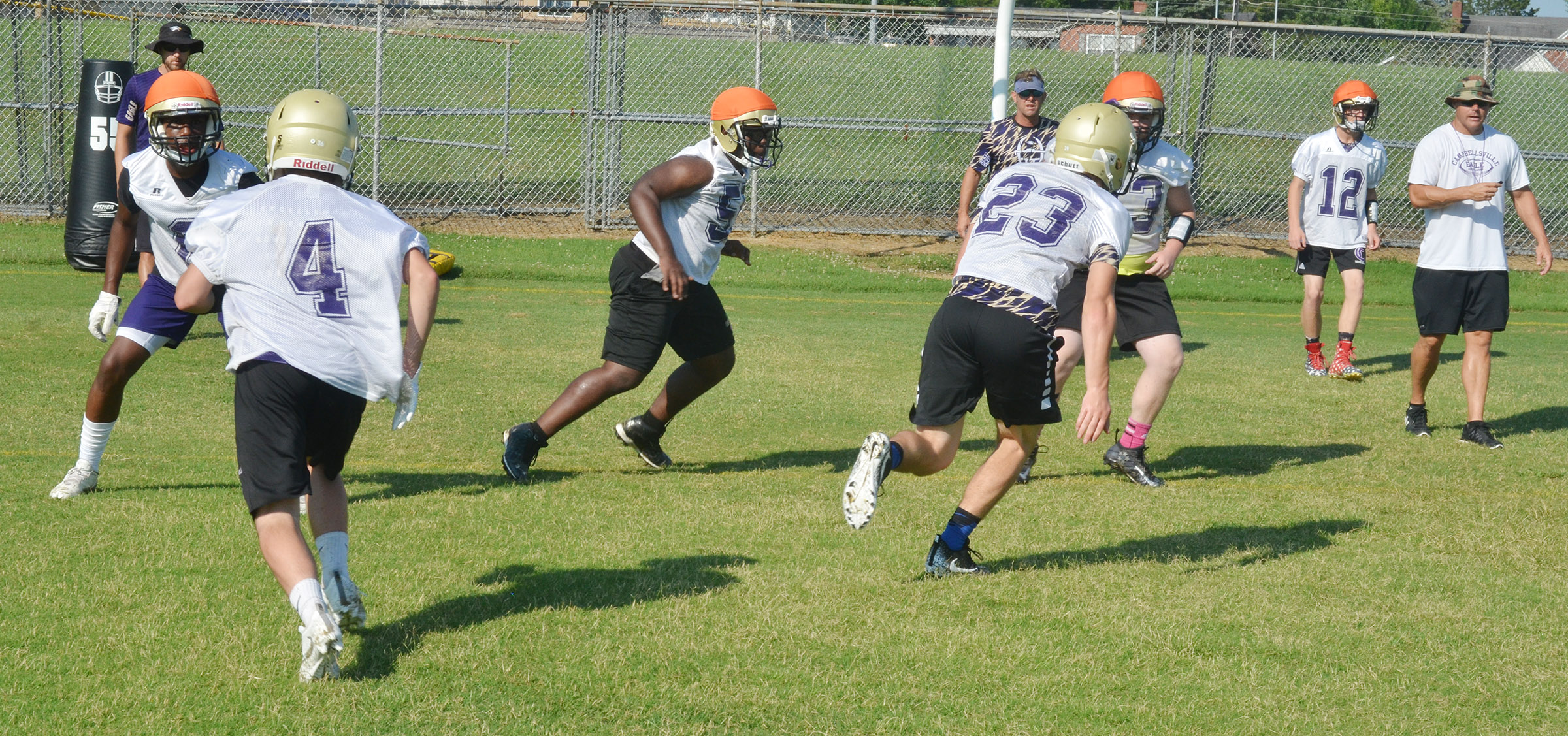 CHS football players run a play.