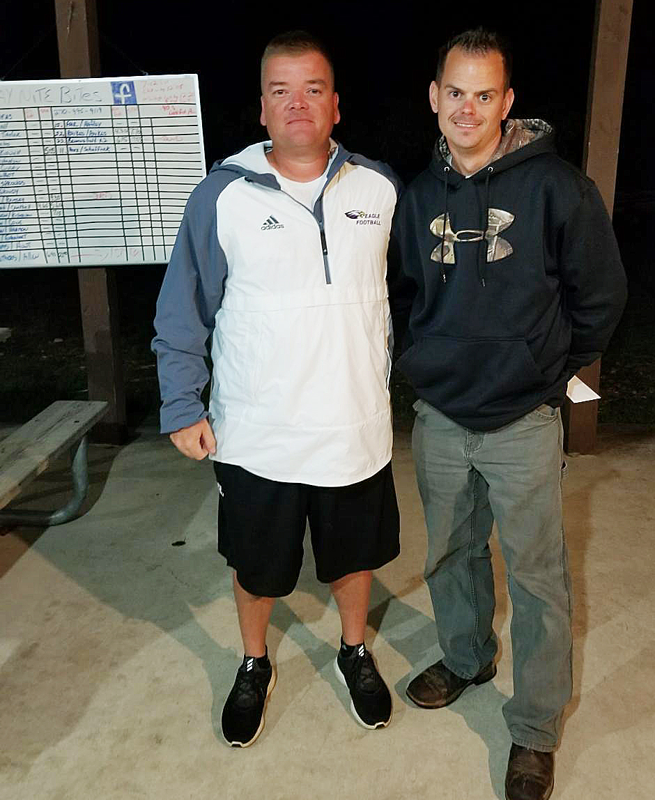 J Ramsey, at right, and Millie Ramsey, not pictured, won third place in the first CHS football bass tournament on Friday, Aug. 4. They won a $150 prize. J Ramsey is pictured with CHS head football coach Dale Estes.