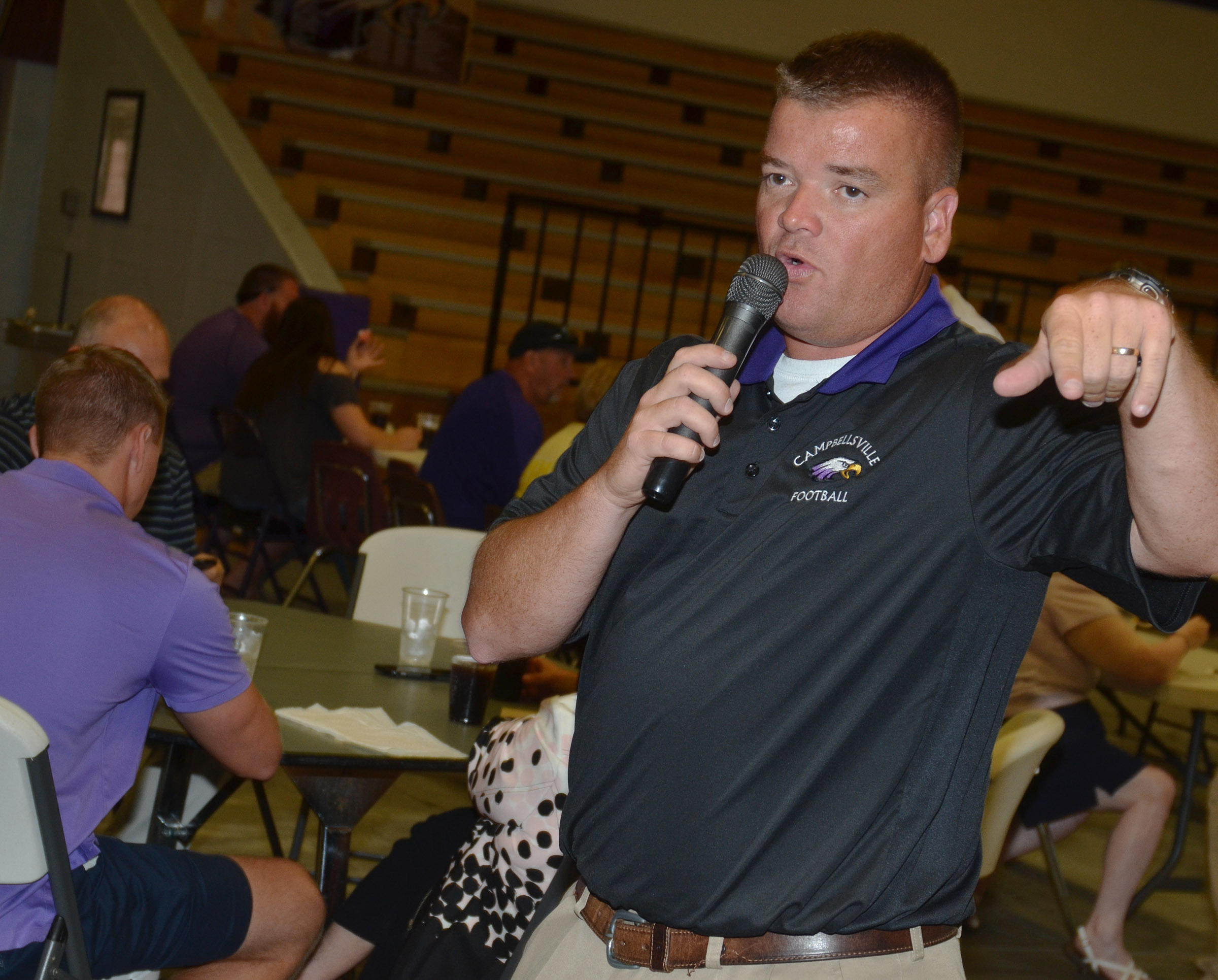 CHS head football coach Dale Estes thanks the crowd for attending the annual CHS football dinner and auction.